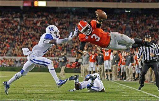 Georgia running back Todd Gurley dives into the end zone for a touchdown against Kentucky on Nov. 23 in Athens, Ga.