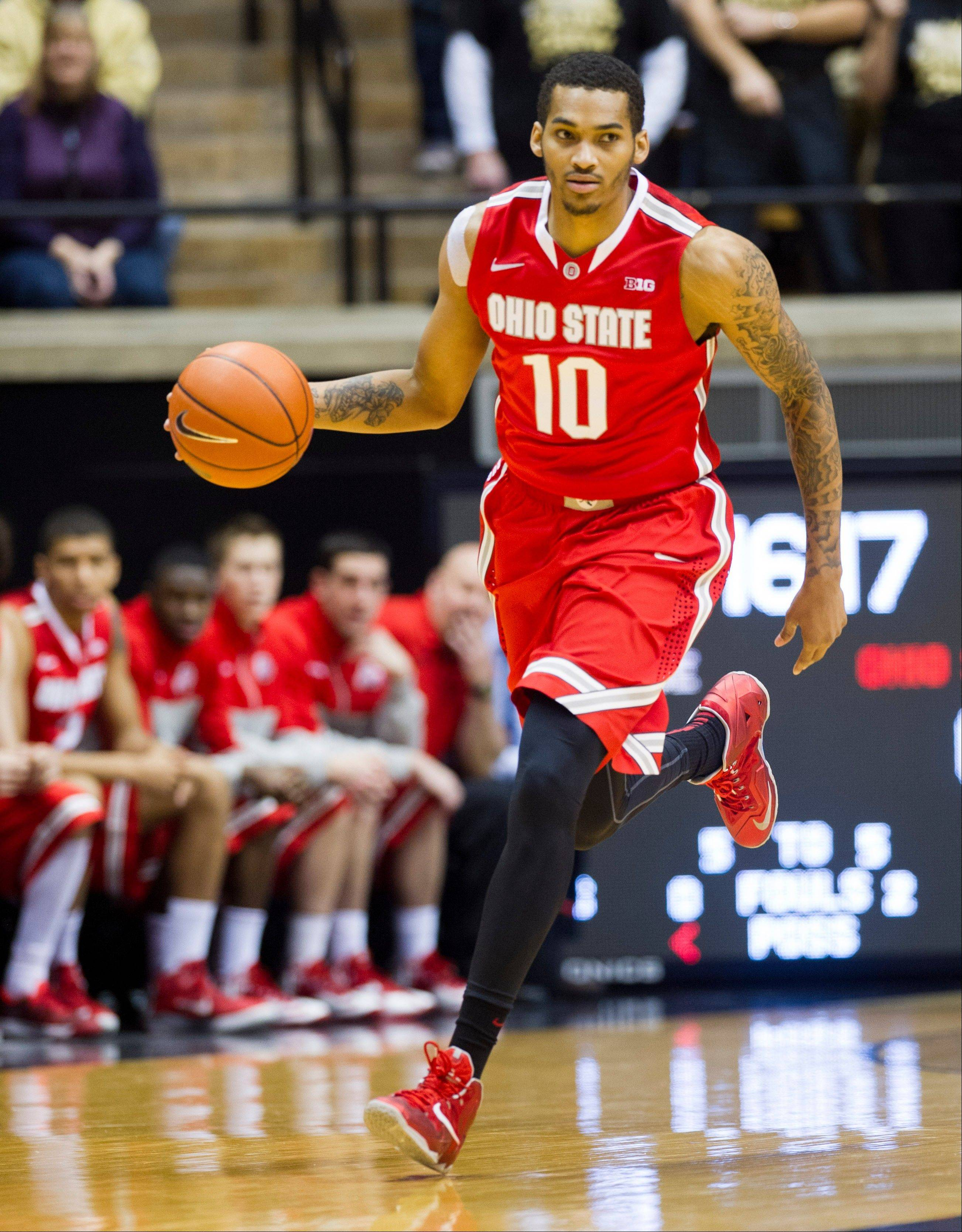 Ohio State's LaQuinton Ross brings the ball up court in the first half of Tuesday's game against Purdue in West Lafayette, Ind.