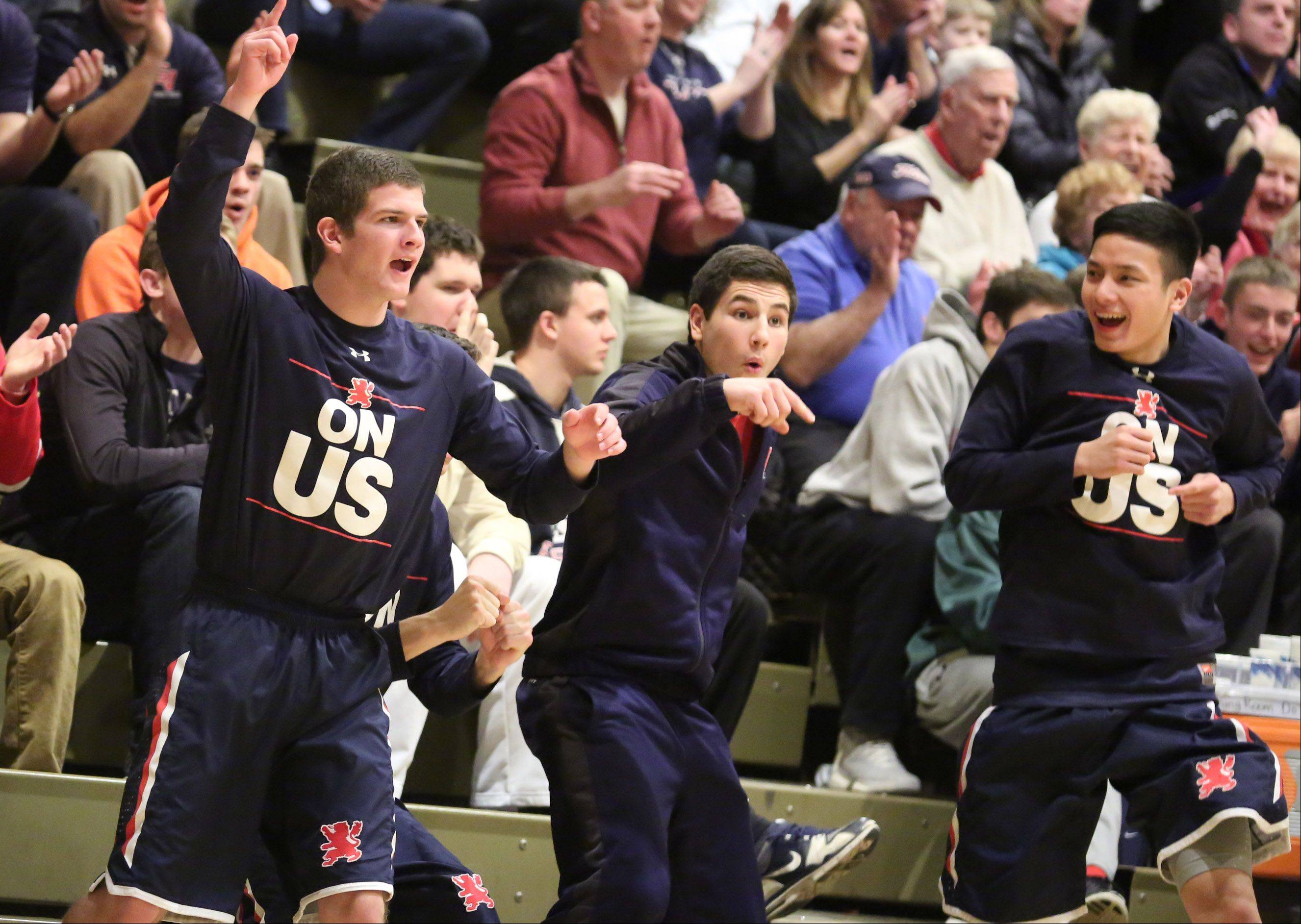 St. Viator players celebrate a three-point shot against Prospect at the Wheeling Hardwood Classic on Friday.