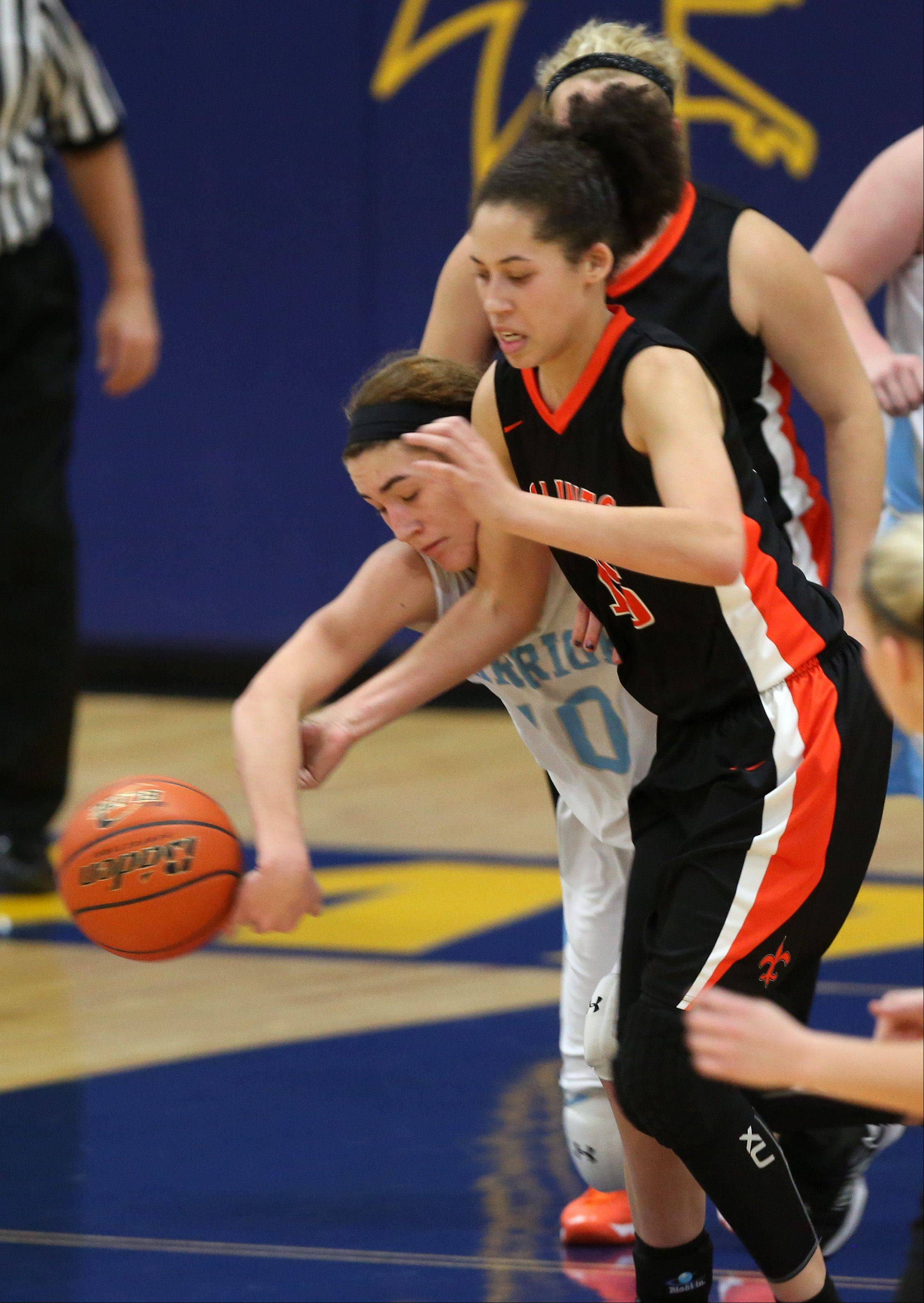 Willowbrook's Molly Krawczykowski, left, battles St. Charles East's Kyra Washington during the Falcon Classic girls basketball tournament at Wheaton North.