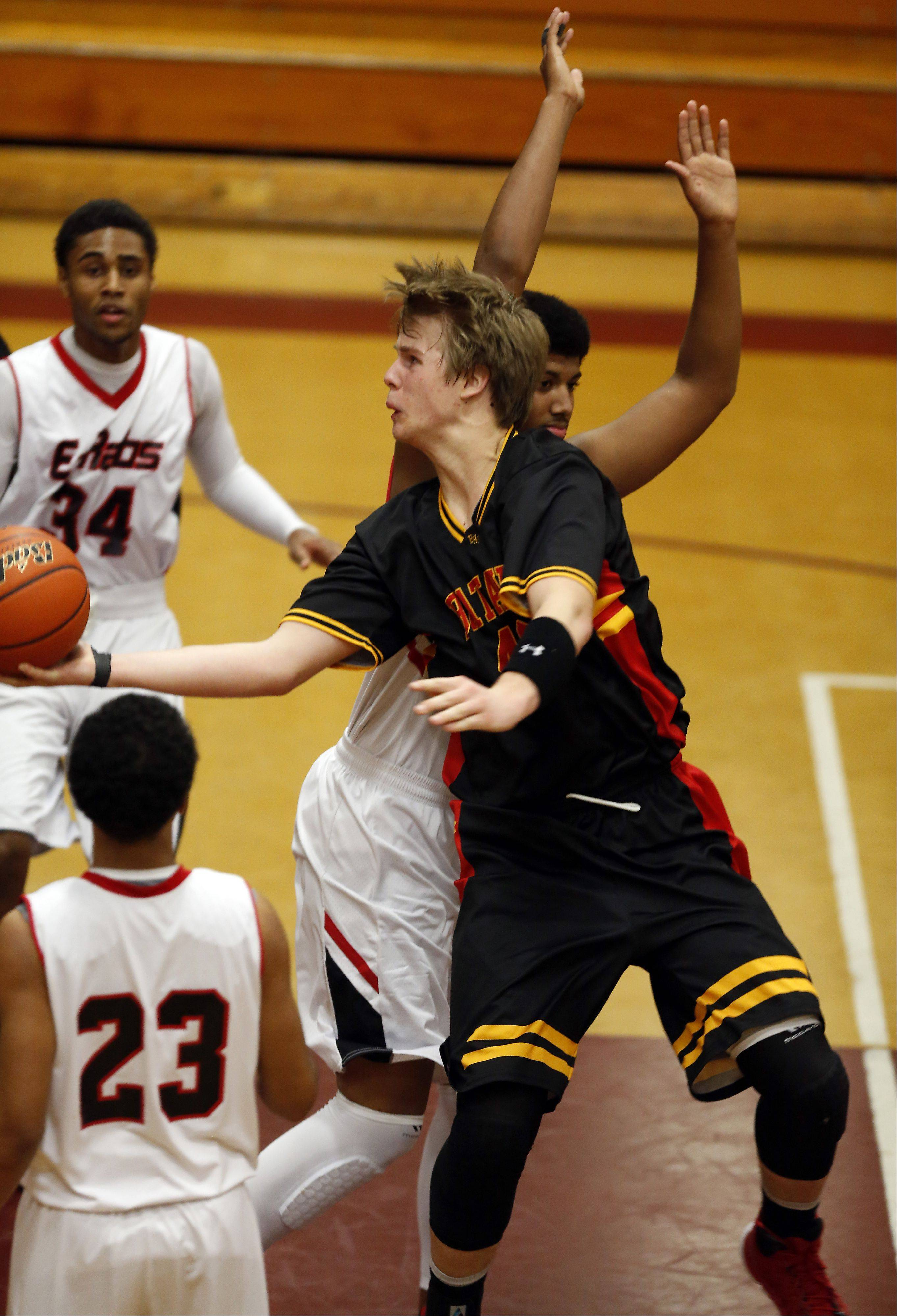 Batavia's Chasen Peez goes strong to the hoop past Rockford East's Bryant Nolan at the 39th Annual Elgin Boys Holiday Basketball Tournament at Elgin High School on Saturday.