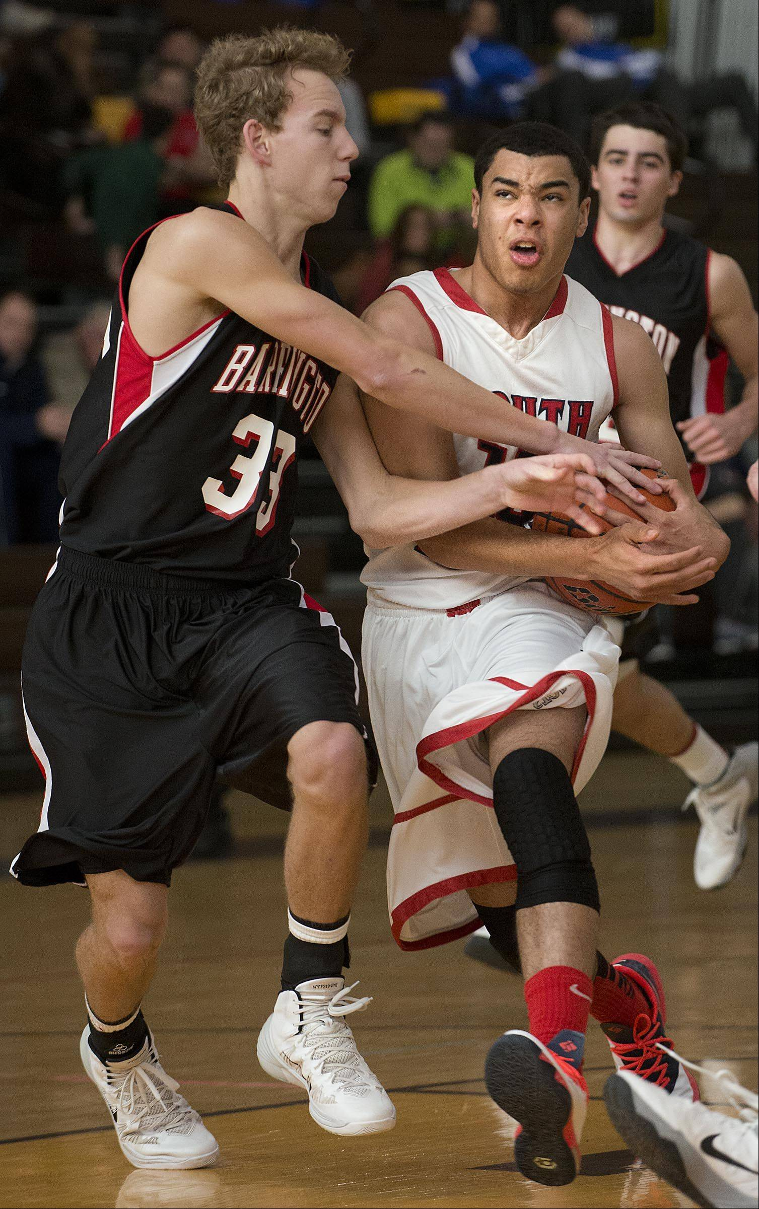 Barrington's Scott Bennett pressures South Elgin's Matthew Smith Monday at the Hinkle Holiday Classic in Algonquin.