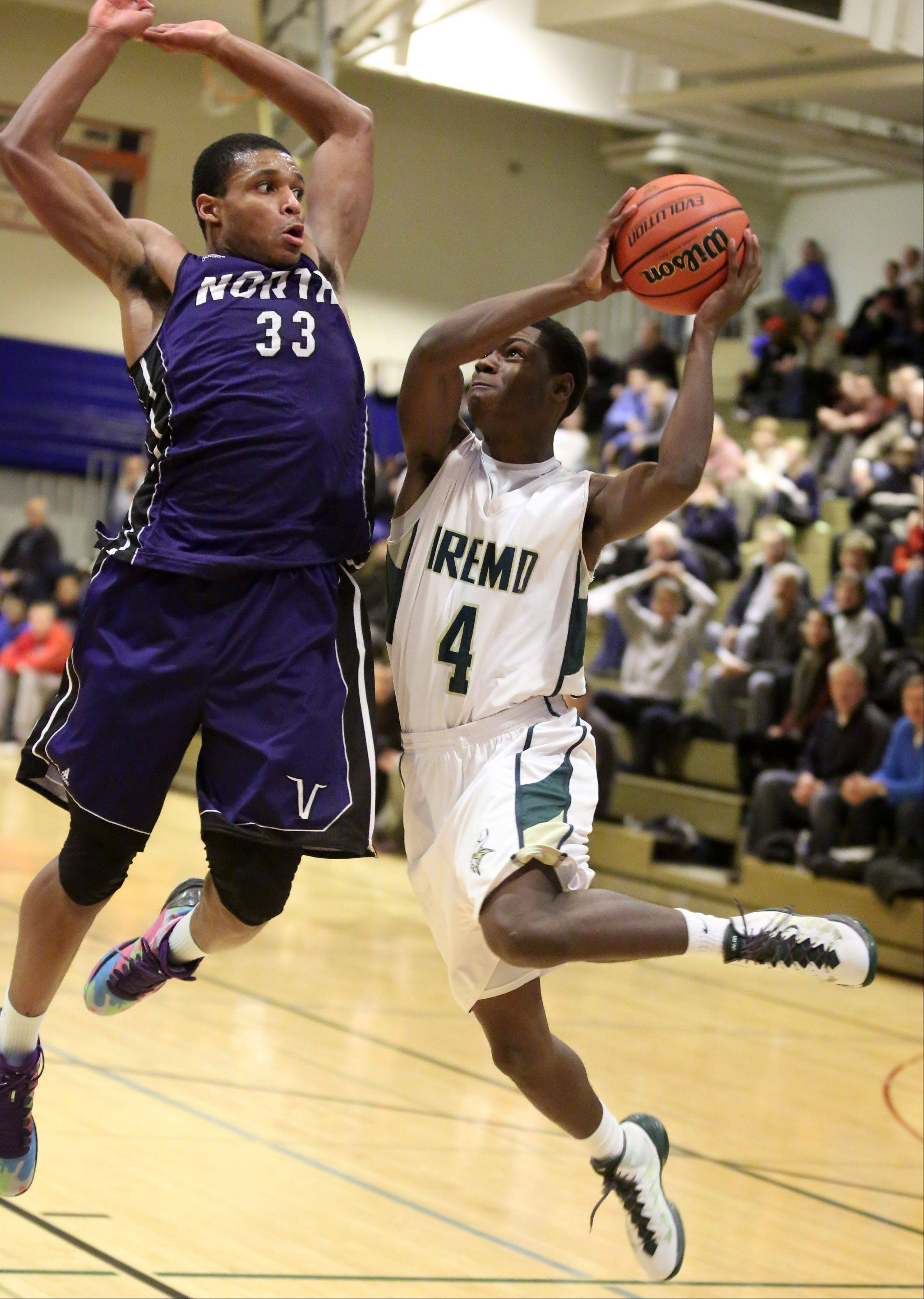 Fremd's Jalon Roundy drives to the basket against Niles North defender Duante Stephens on Thursday at the Wheeling Hardwood Classic.