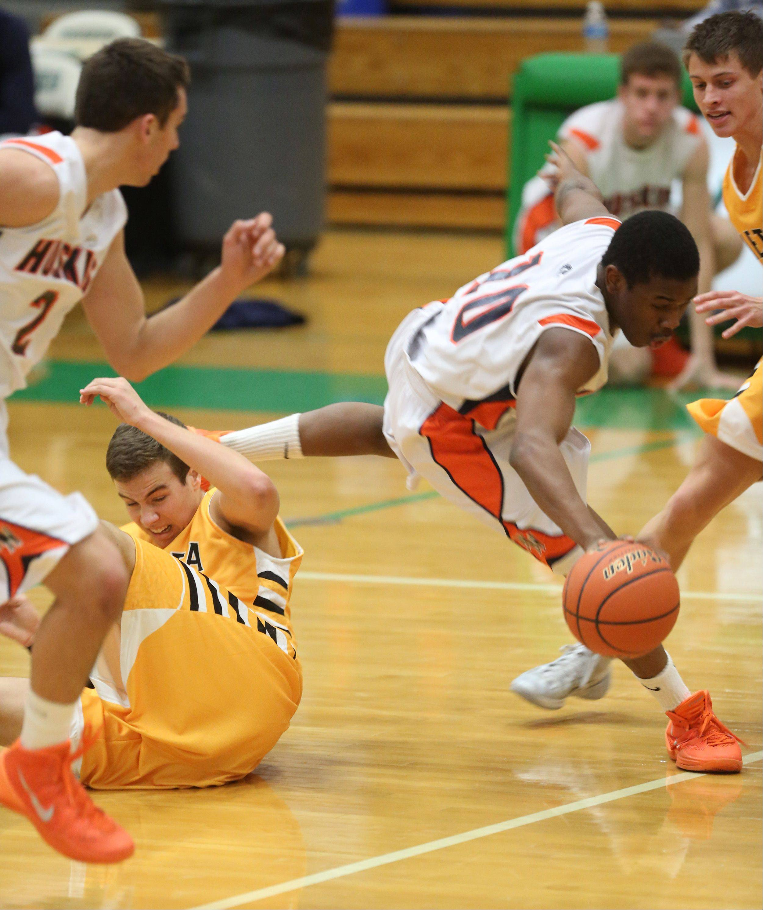 Naperville North's Jelani McClain Jr. drives past the Metea Valley defense during Thursday's Jack Tosh Holiday Classic basketball tournament.