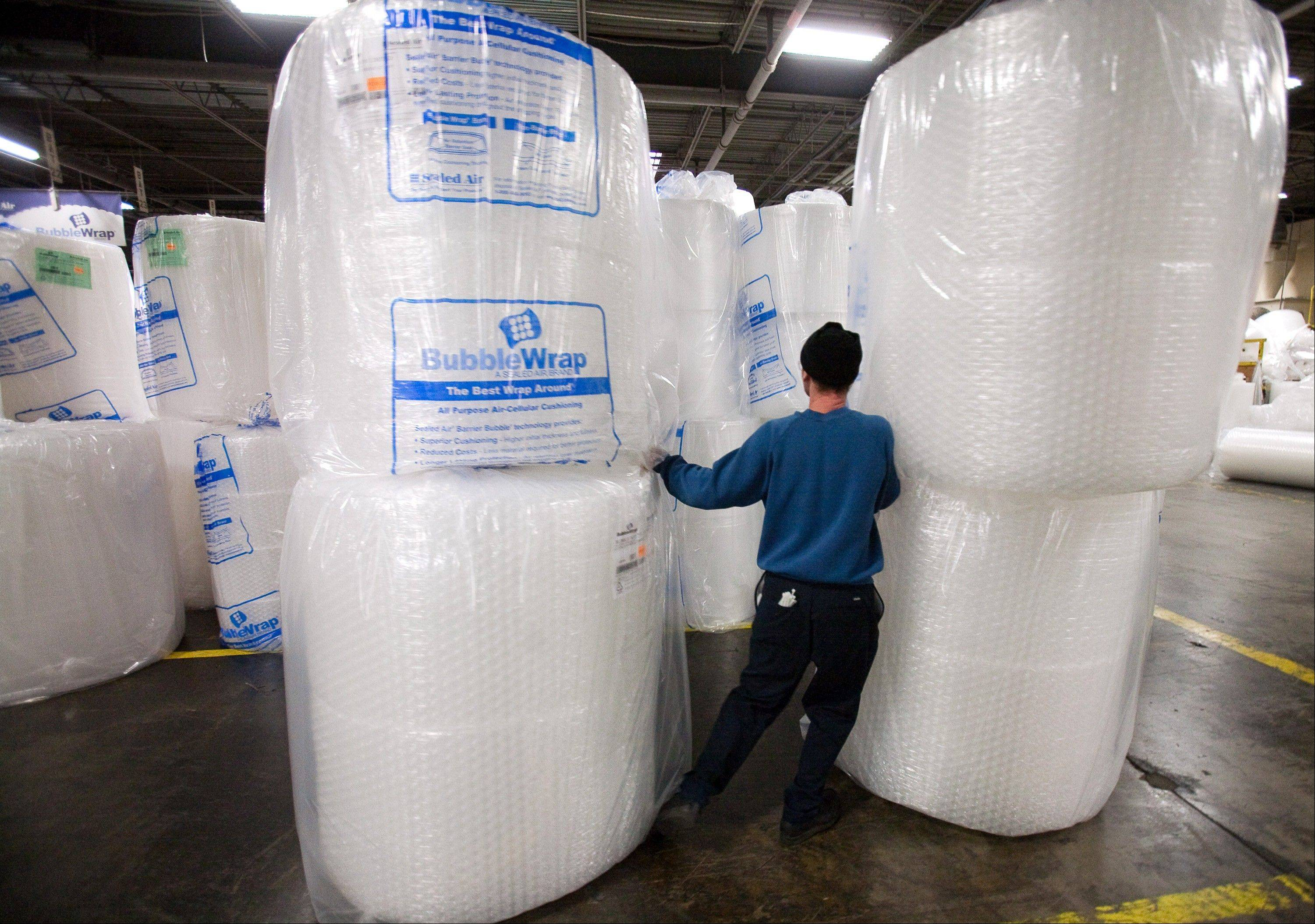 Sealed Air employee Eddie Ruiz moves giant rolls of Bubble Wrap at the company�s plant in Saddle Brook, N.J. Sealed Air led the gains in the materials sector in 2013 after returning to profitability. This year�s gain: 22 percent.