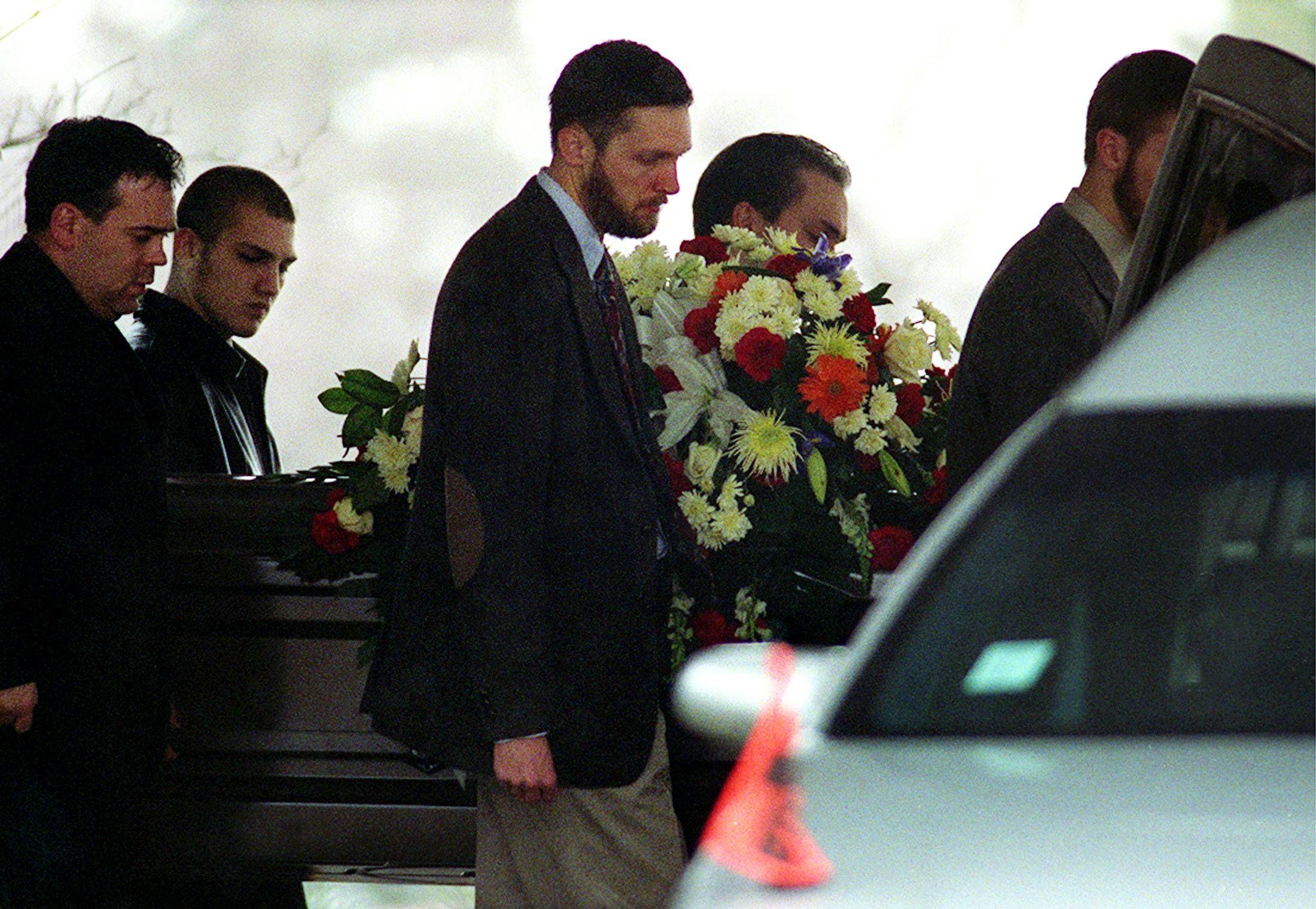 Pallbearers carry Andy Davidson's casket after his funeral Wednesday at Evangelical Free Church.