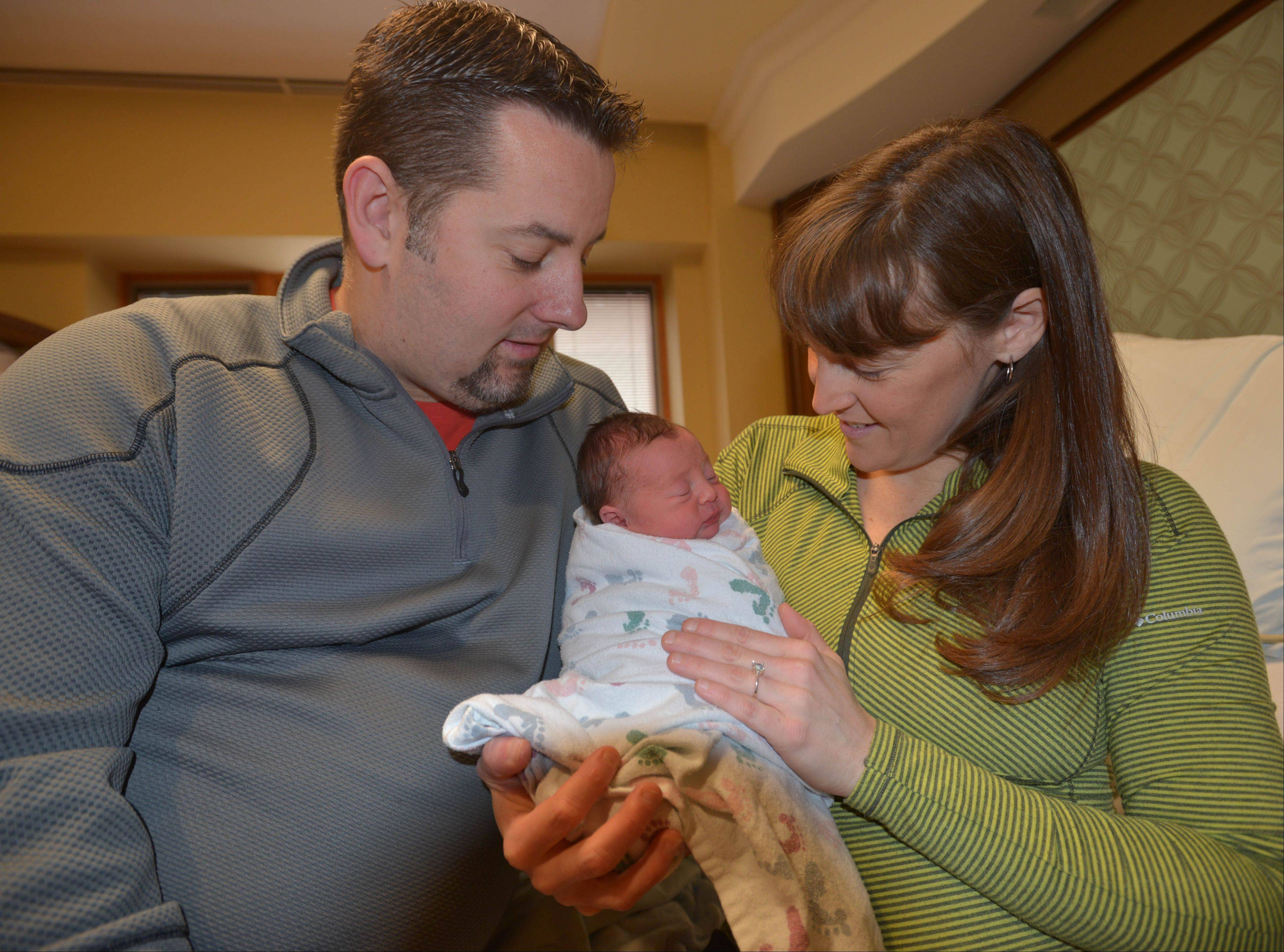 Steve and Kelle Lalko of Aurora hold their newborn daughter, Ella Marie, at Edward Hospital in Naperville. Ella was born at 1:11 a.m. Wednesday, weighing 5.8 pounds and at 18 inches long. She was the first baby born in 2014 in DuPage County.