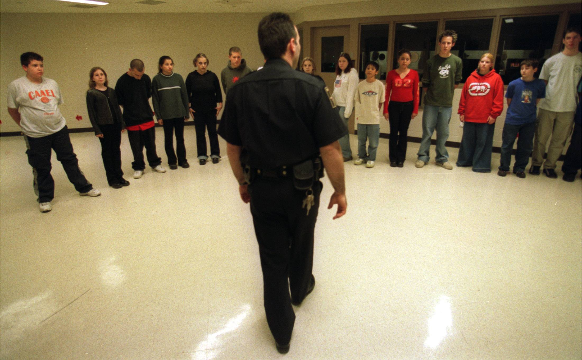 Tour Coordinator and Training Liaison Deputy John Mondelli lines up the participants during H.E.A.L's scared straight tour of the DuPage County Jail in Wheaton Tuesday night.