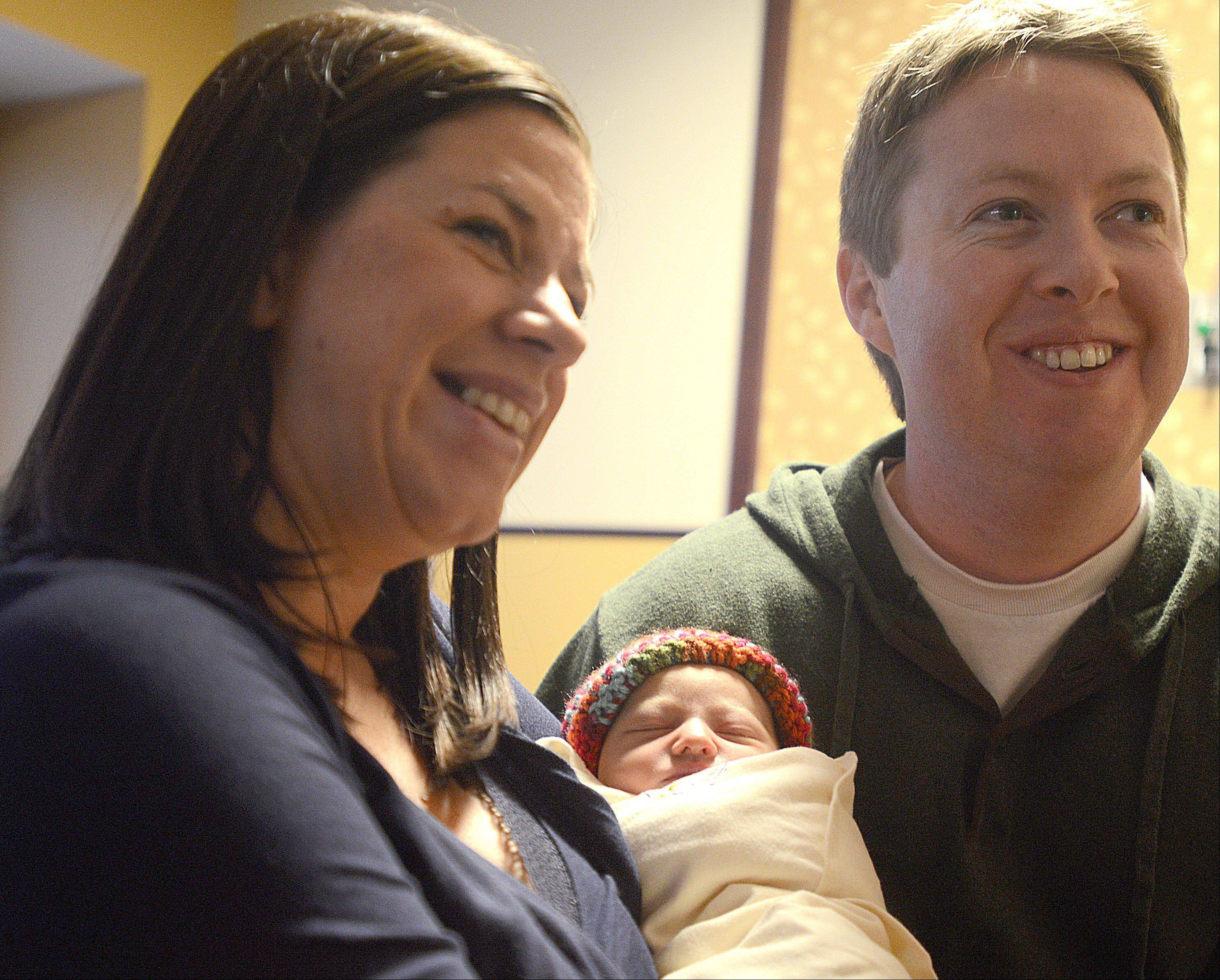 Erin and Jason Curtin of Crystal Lake visit with their daughter, Maci, who was born at 12:31 a.m. on New Year's Day at Advocate Good Shepherd Hospital in Barrington. Maci, who checked in at 6 pounds, 4 ounces and measured 20 inches long, was the first baby born in 2014 in Lake County.