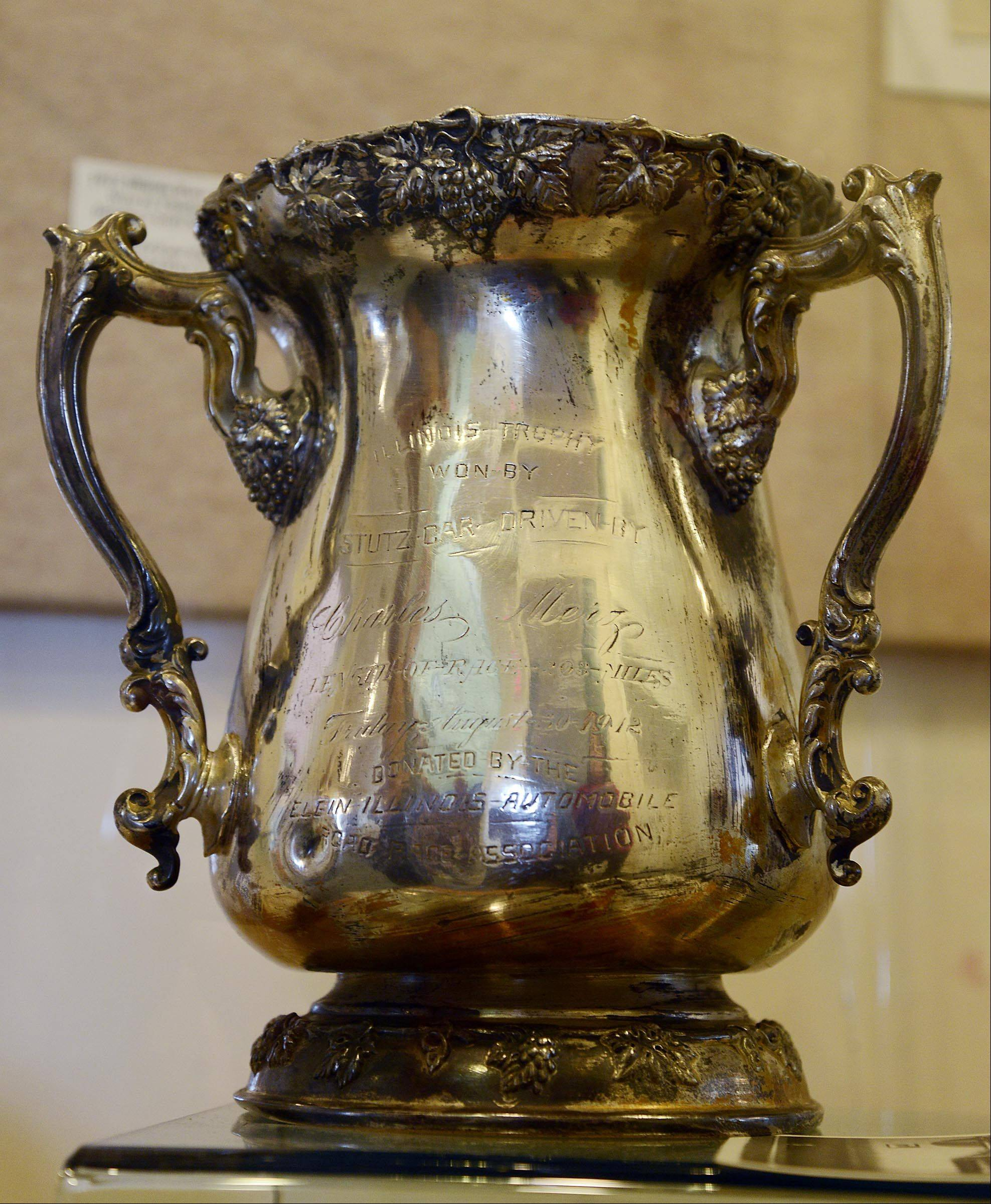 The large silver trophy, known as the Illinois Cup, won by Charles Merz in the 1912 Elgin National Road Race is now in the Elgin History Museum, thanks in part to Maurice Dyer, Elgin Historical Society board member.
