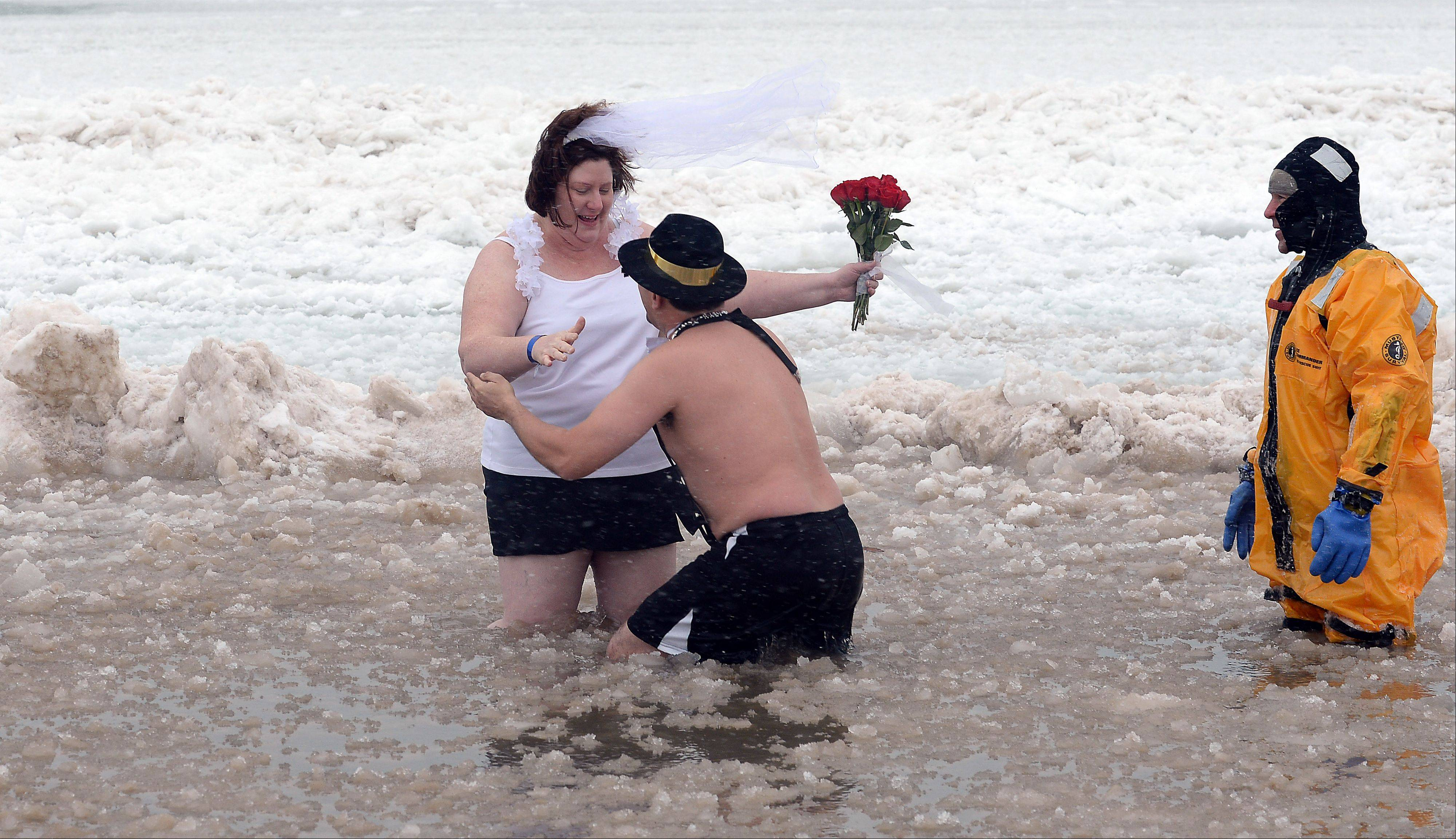 Felix Monterrosa and Tanya Fretheim show their love for each other at the plunge- they are engaged to be married in June.