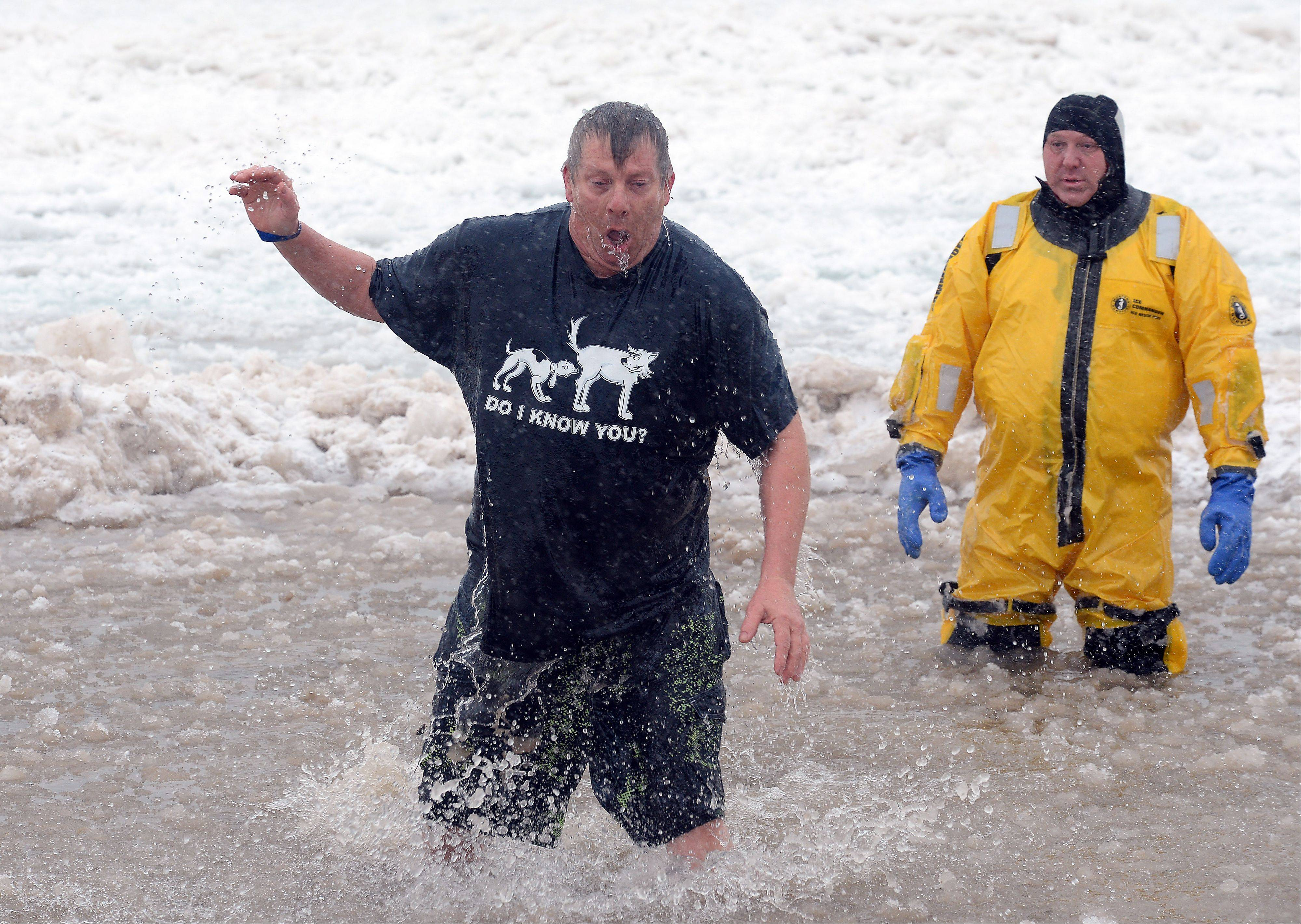 Dave Madlener of Chicago feels the sting of the freezing water.