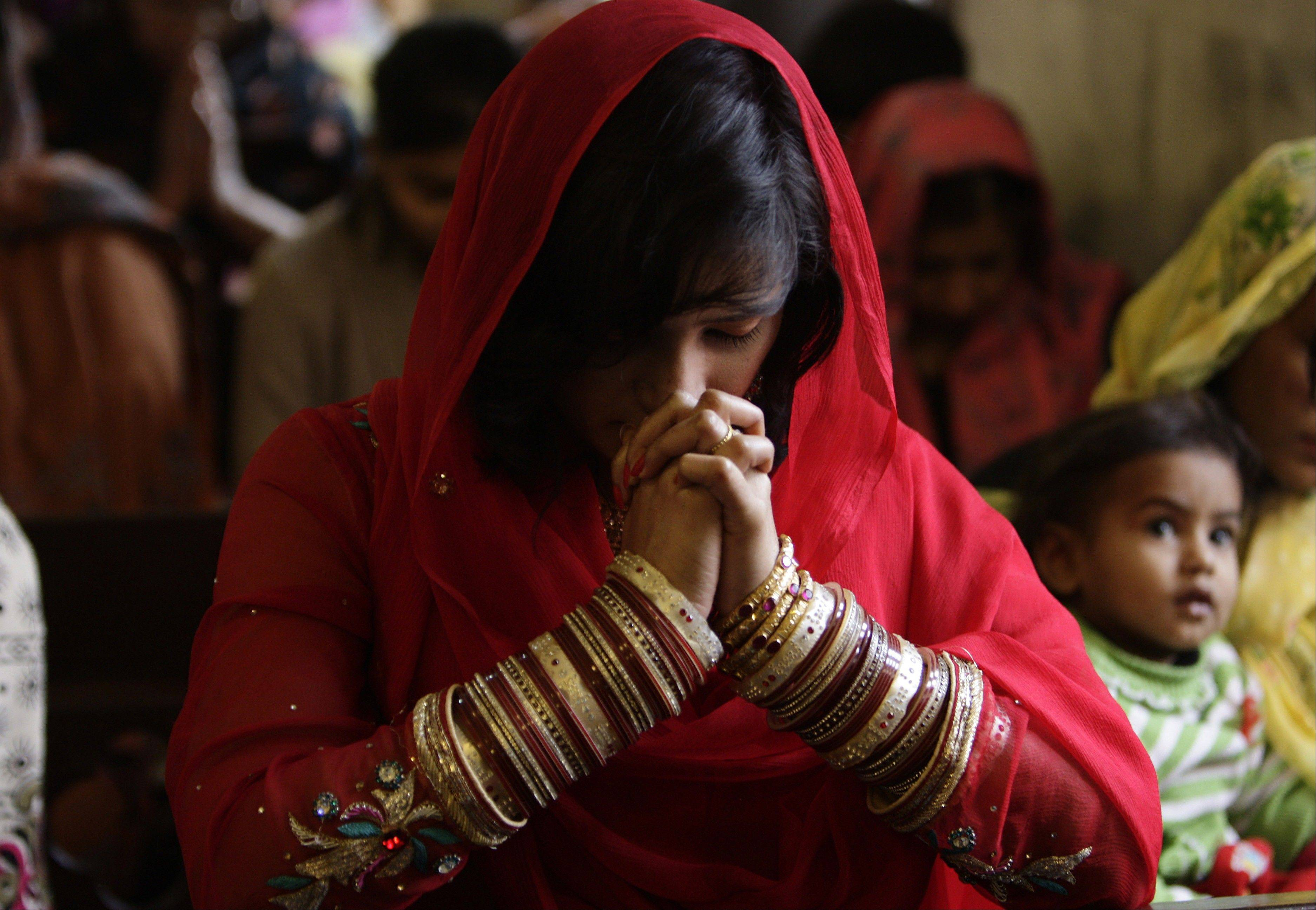 Pakistani Christians attend a prayer service on the first day of the New Year at a local church in Lahore, Pakistan, Wednesday, Jan. 1, 2014.