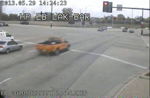 A still from a Hanover Park red-light camera shows an Illinois Department of Transportation vehicle running a red light in May. The driver of the car used agency stationery to get out of the ticket and is being investigated.