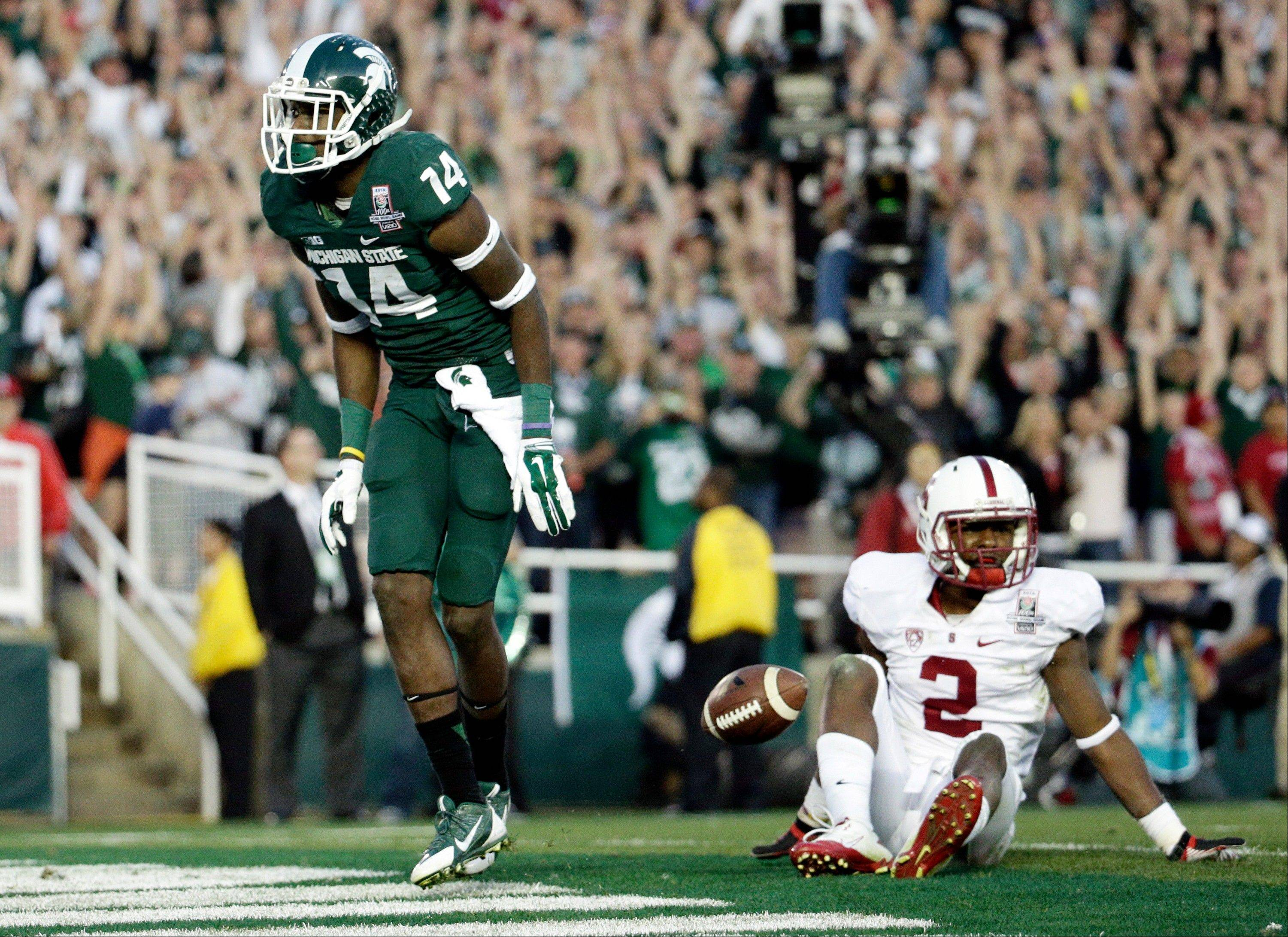 Michigan State wide receiver Tony Lippett celebrates his touchdown past Stanford cornerback Wayne Lyons, during the second half of the Rose Bowl NCAA college football game on Wednesday, Jan. 1, 2014, in Pasadena, Calif.