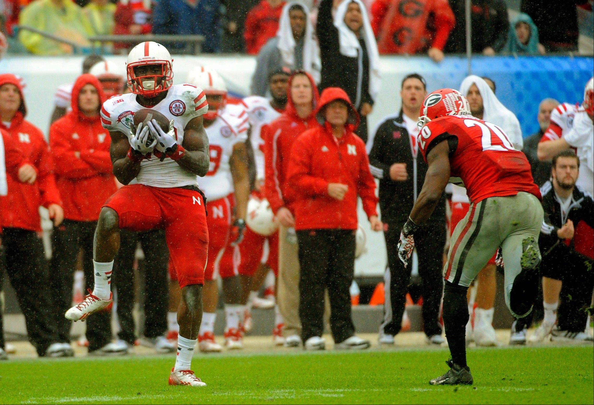 Nebraska wide receiver Quincy Enunwa (18) catches a pass for a 99-yard touchdown reception during the second half of the Gator Bowl NCAA college football game against Georgia, Wednesday, Jan. 1, 2014, in Jacksonville, Fla. Nebraska beat Georgia 24-19.