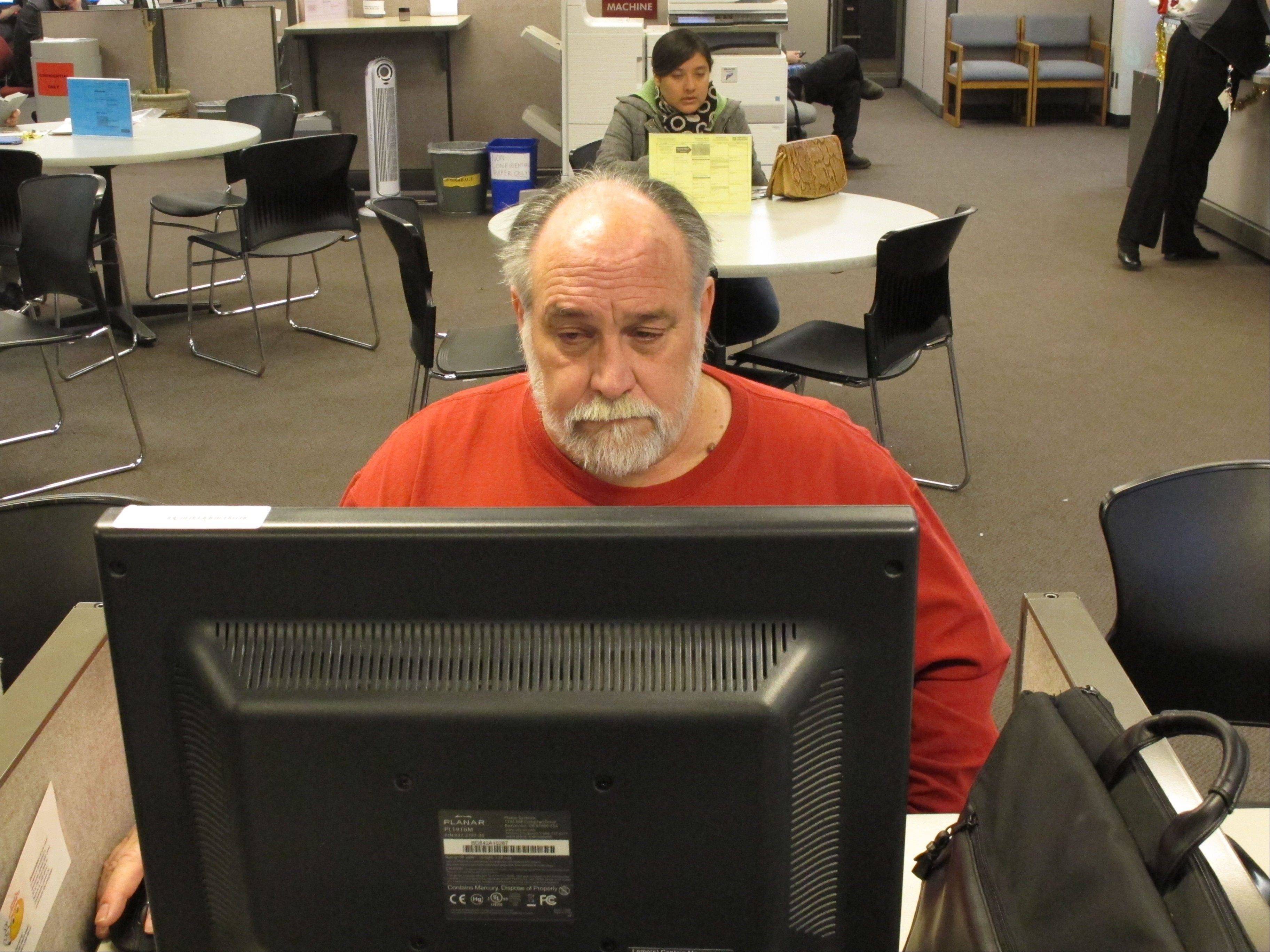 Richard Mattos, 59, looks for jobs at a state-run employment center in Salem, Ore.