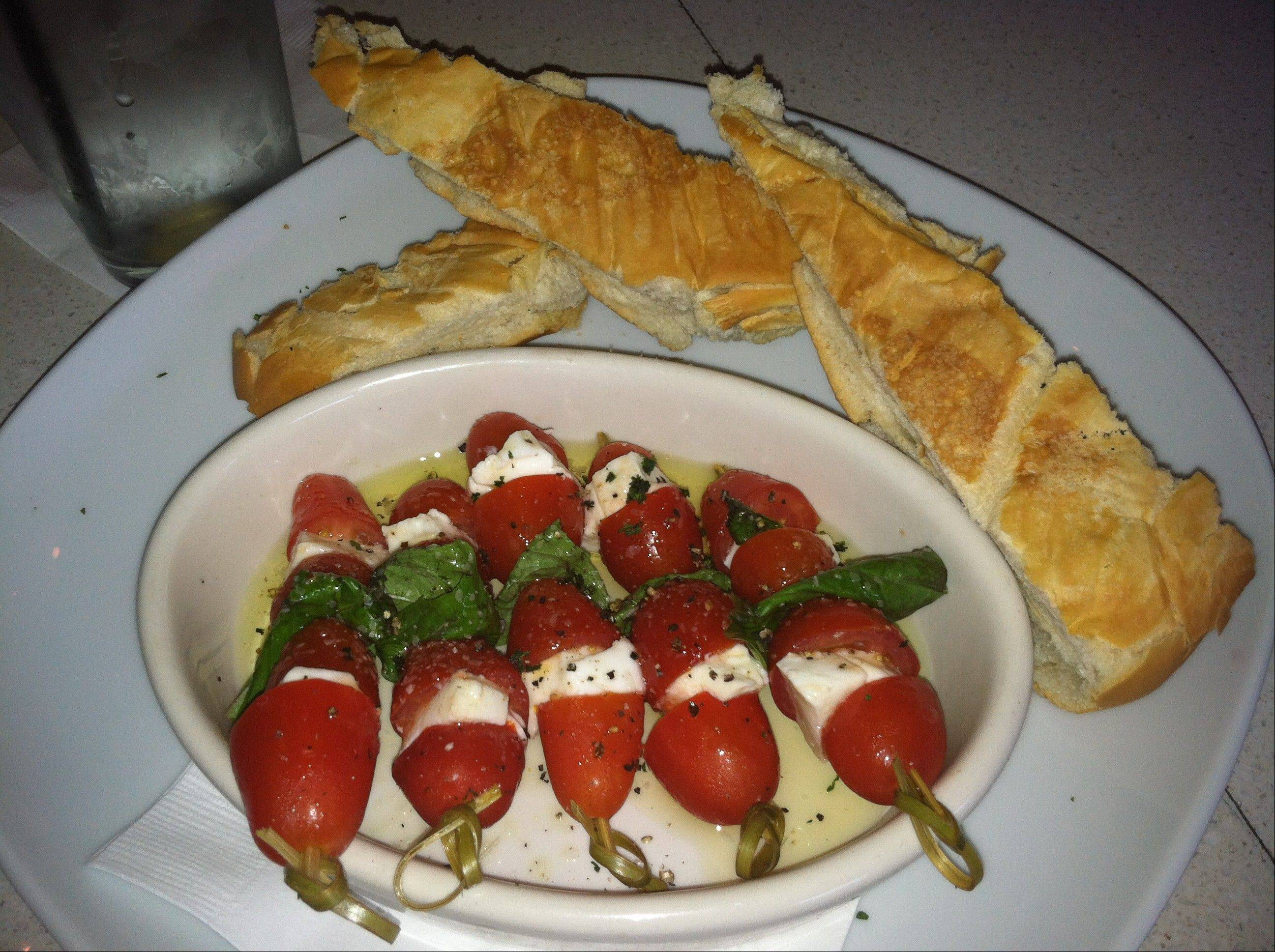 Caprese skewers with tomatoes, mozzarella and basil on skewers are served up at Queenshead, a restaurant in the emerging, funky Grand Central District of St. Petersburg, Fla.