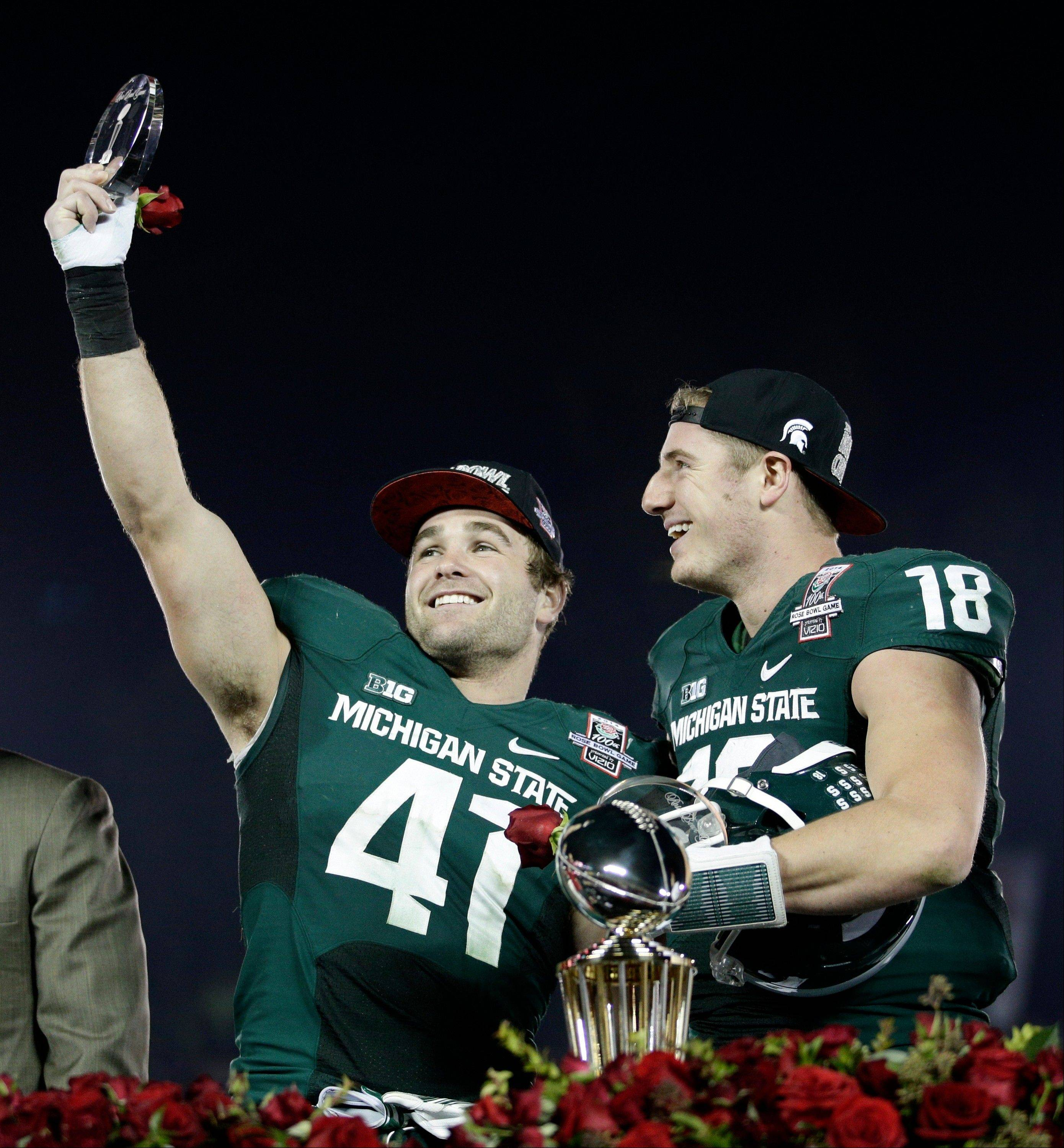 Linebacker Kyler Elsworth, left, celebrates with quarterback Connor Cook after Michigan State defeated Stanford 24-20 in the Rose Bowl on Wednesday night. Elsworth is a senior, but Cook will be back next season as a junior.