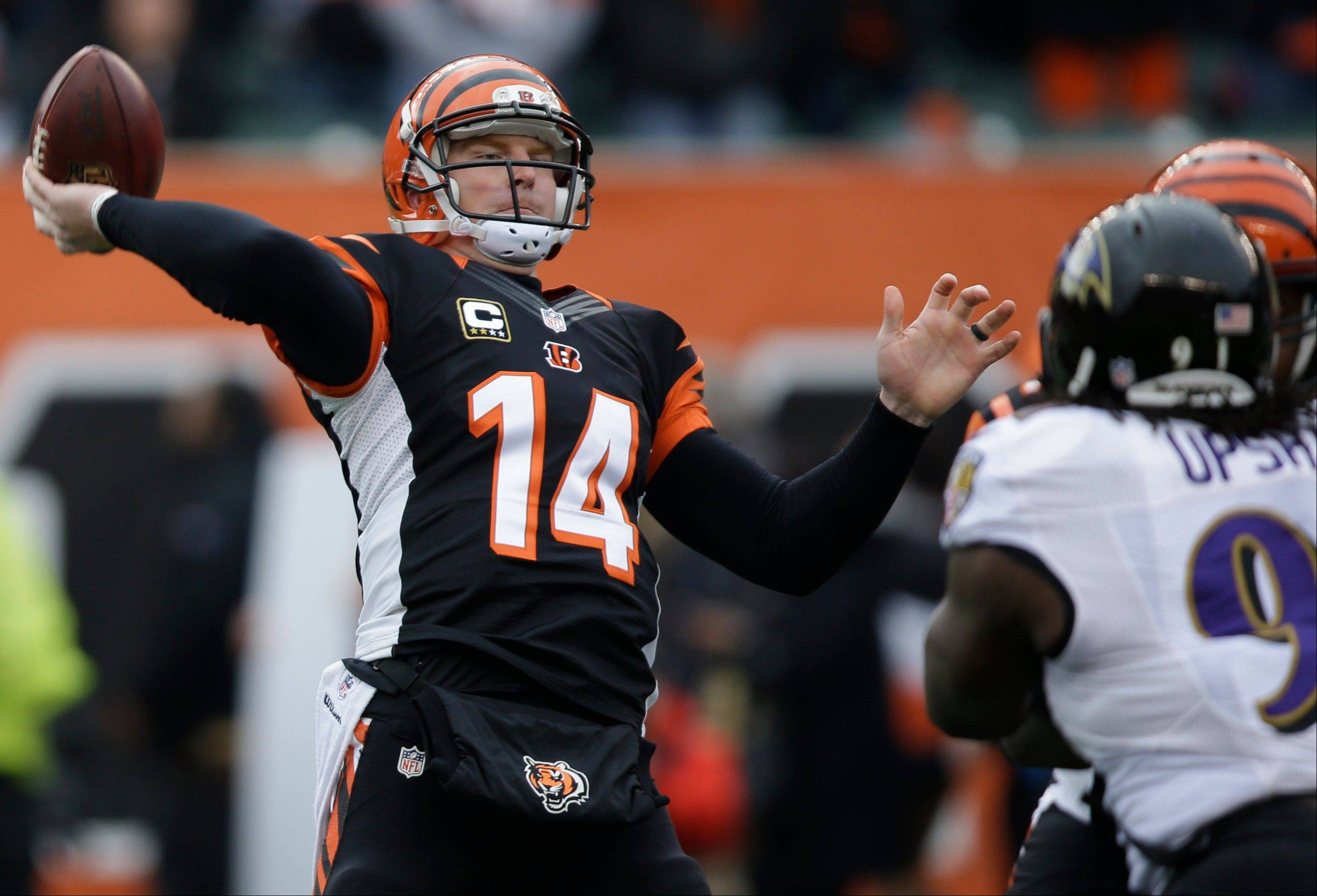 Cincinnati quarterback Andy Dalton throws a pass against the Baltimore Ravens in the first half of last week�s game. The Bengals finished in the top 10 in offense and defense this season for the first time since 1989.