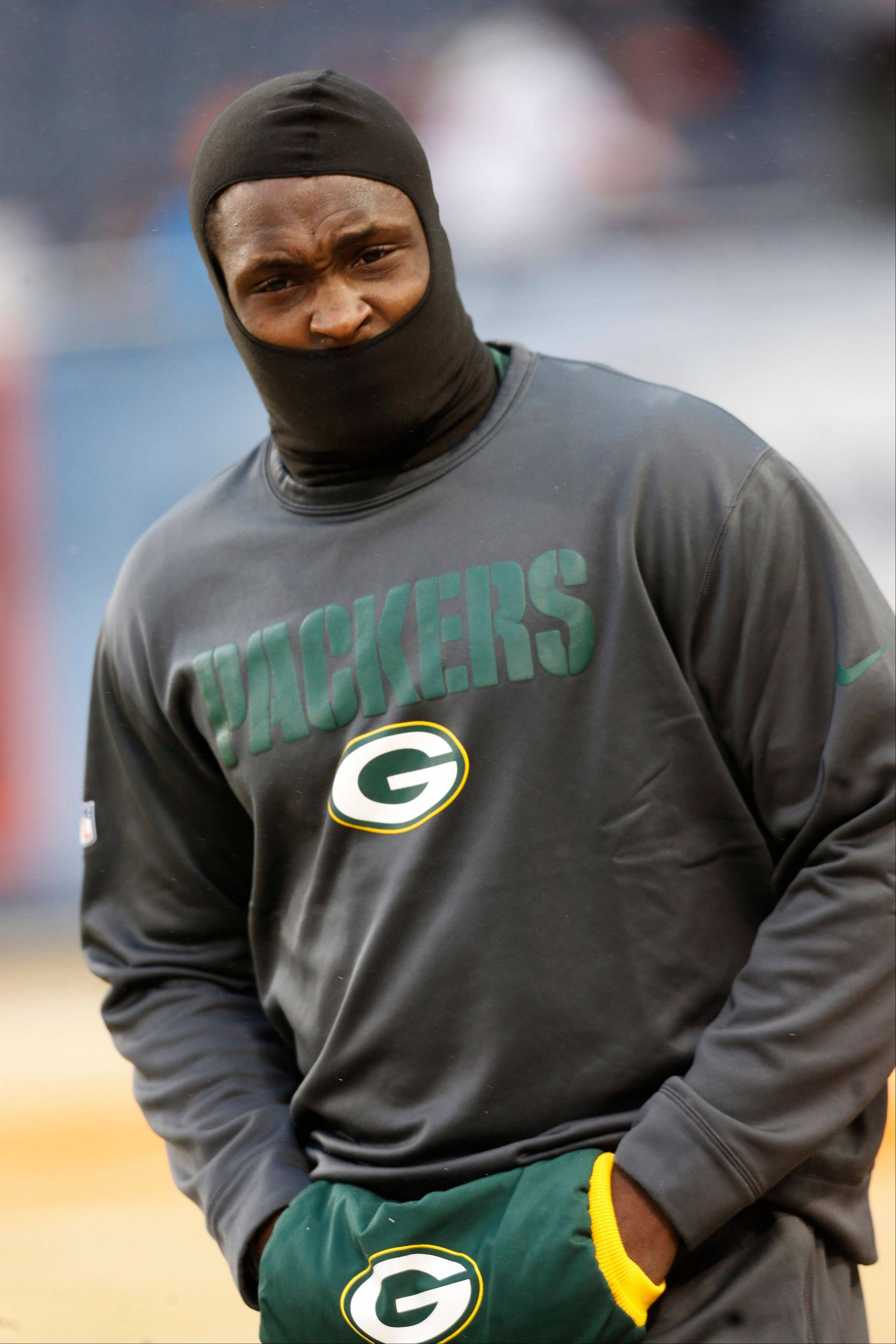 Green Bay linebacker Nate Palmer bundles up before last week�s game against the Bears at Soldier Field. Temperatures will be in the single digits and dropping when the San Francisco 49ers and Packers kick off Sunday afternoon.