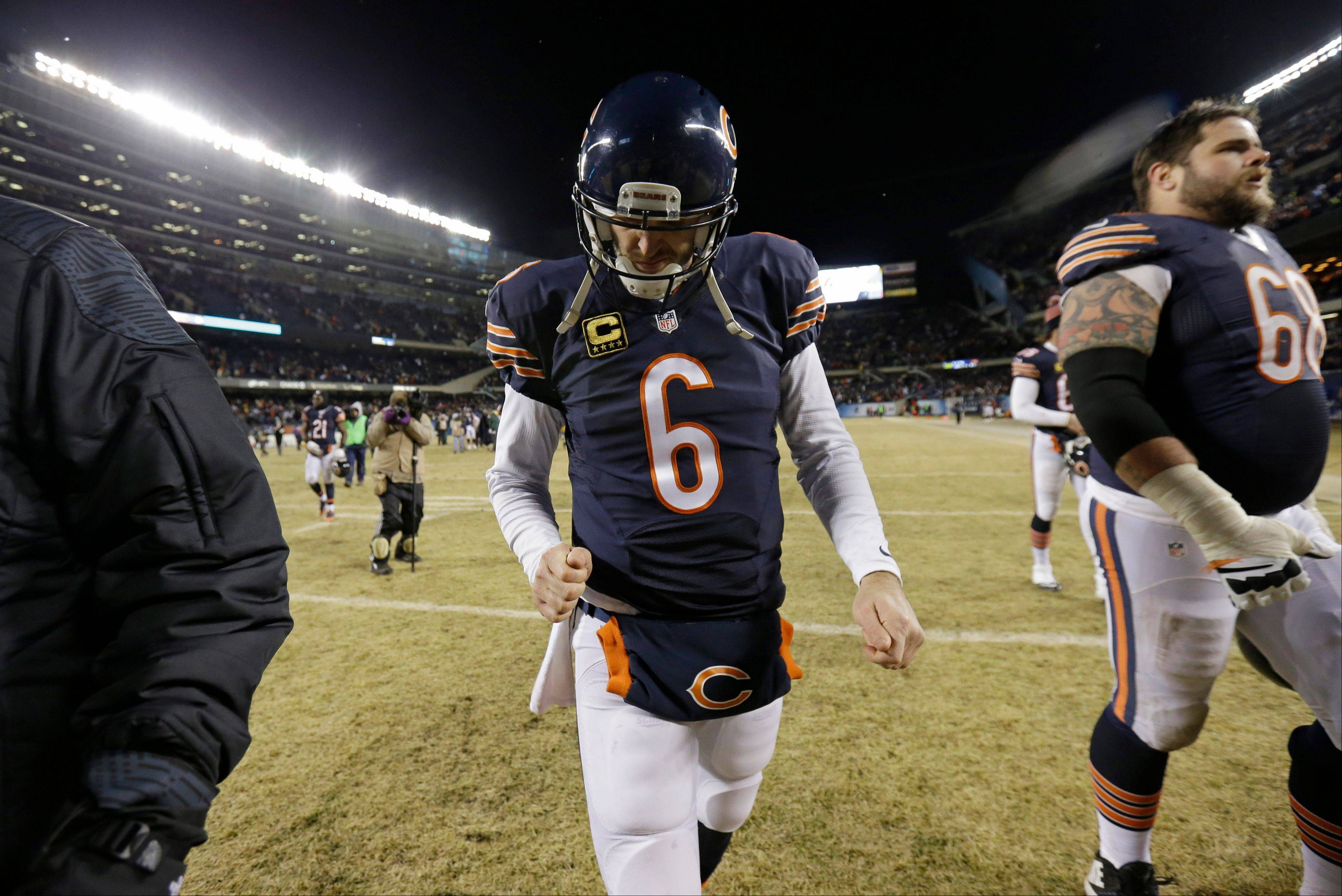 Bears quarterback Jay Cutler walks off the field after the Sunday's 33-28 loss to Green Bay.