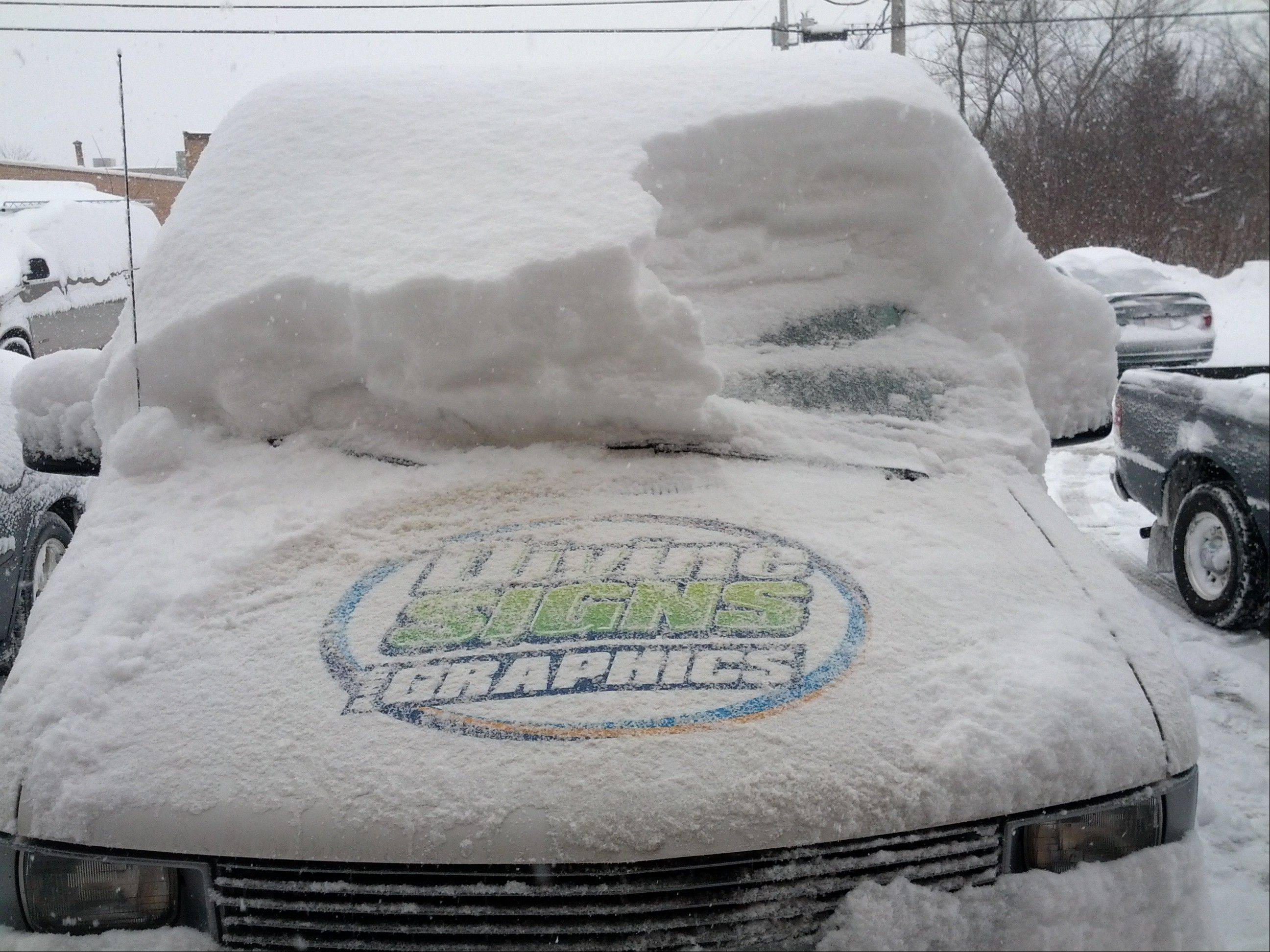 The snow-covered van owned by Divine Signs and Graphics in Schaumburg.