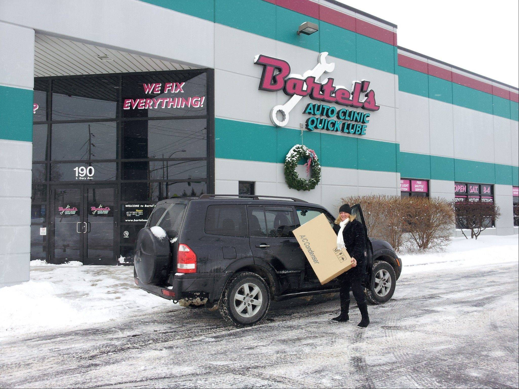 MaryAnn Hogan, customer service manager, goes out into the snowstorm on Thursday to pick up a part for a customer's car being serviced at Bartel's Auto Clinics.