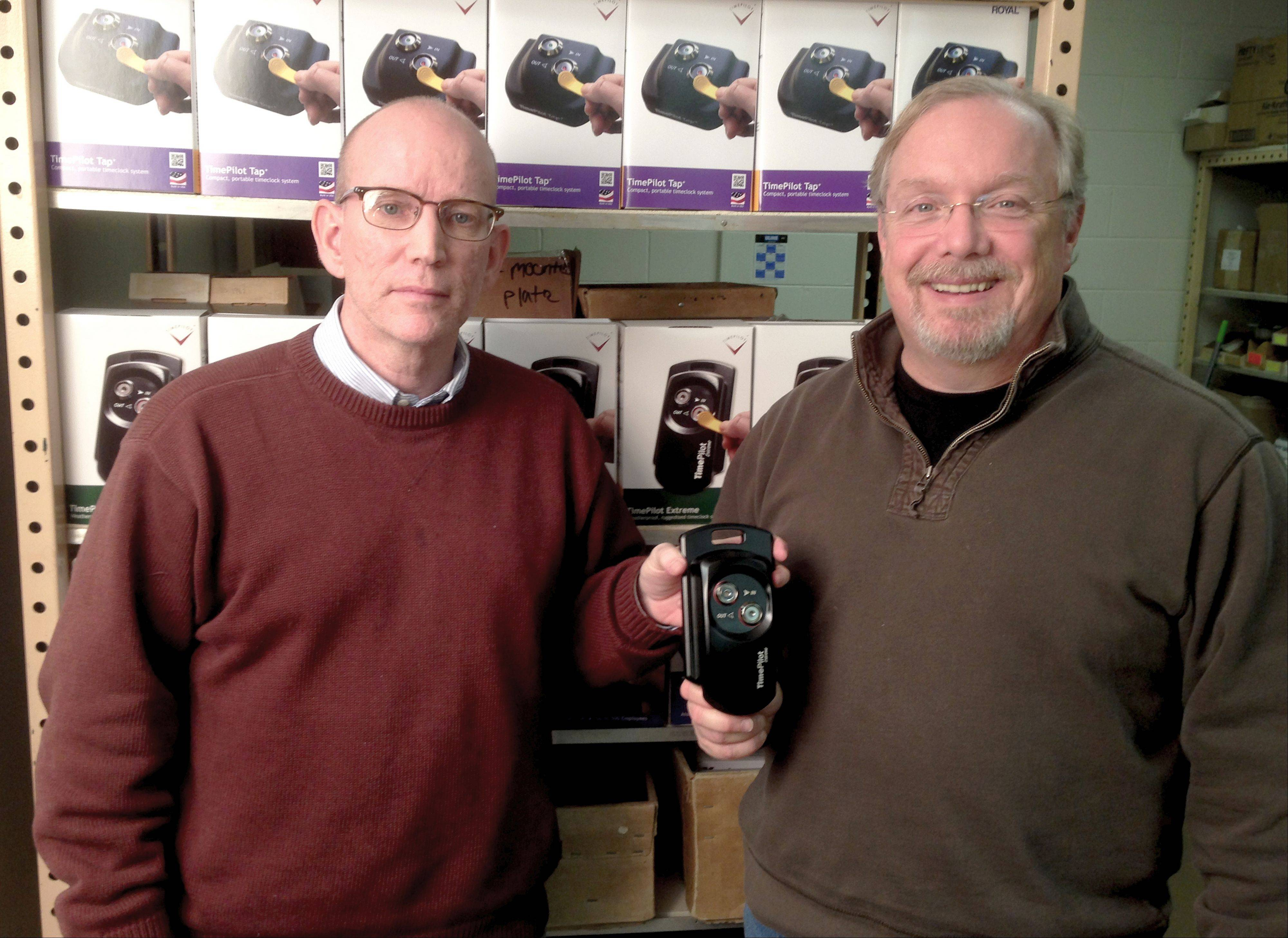 Doug Marsh, TimePilot CEO at left, and Mike Hanlon, TimePilot design director, hold the TimePilot Extreme, the basis for the company's Kickstarter Project called Extreme Blue. They co-founded the company in 2001.