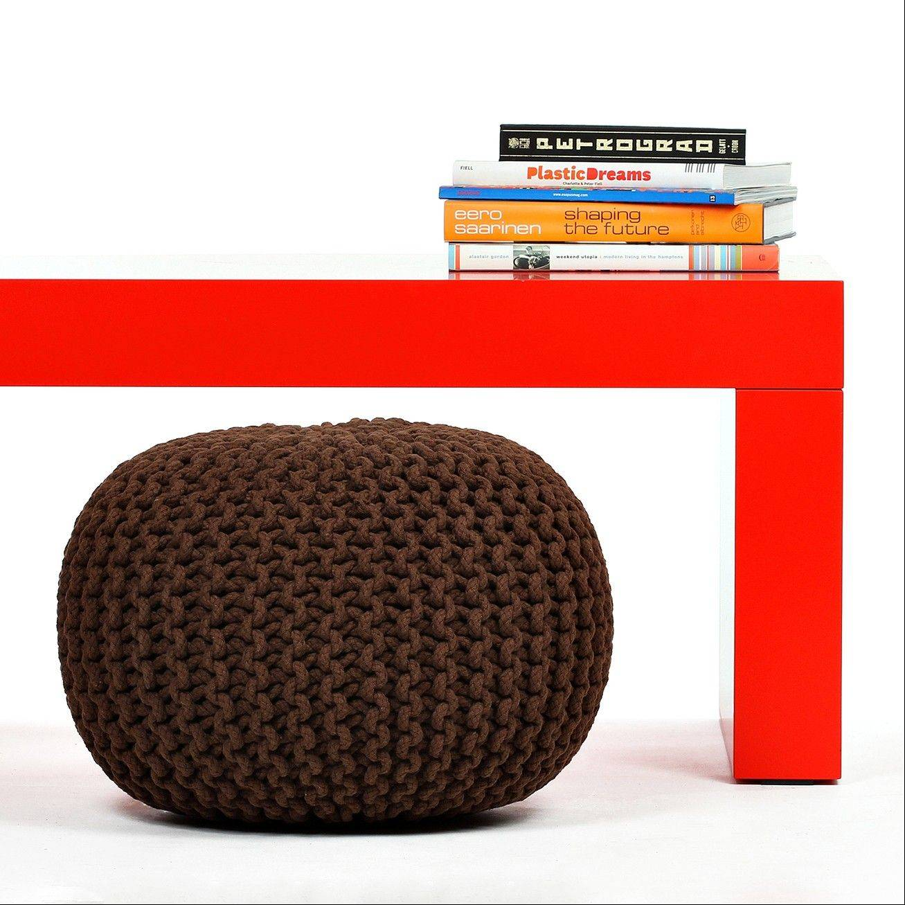 Poufs like these from Fab.com offer low profile seating in a play space. With knitted, faux leather or kilim style upholstery, poufs are stylish, rugged and portable -- perfect for a modern home play space.