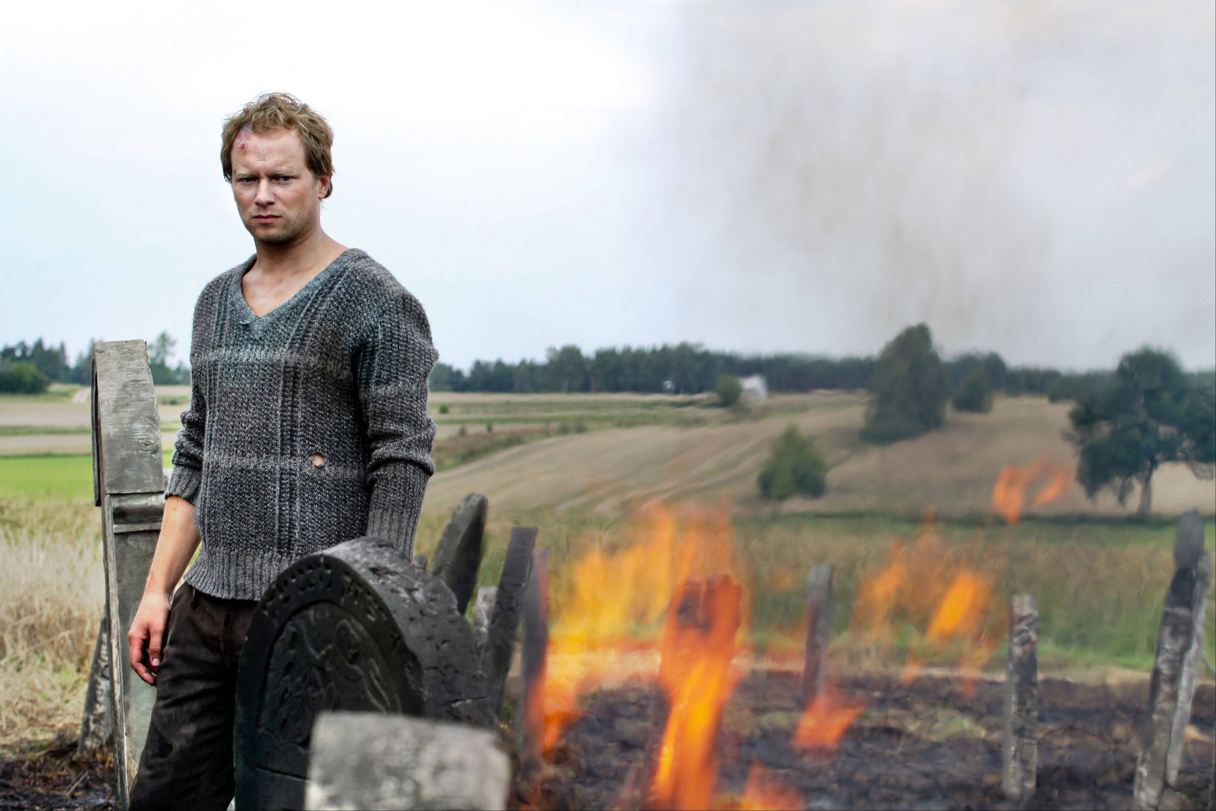 "Jozek Kalina (Maciej Stuhr) is compelled to return desecrated Jewish cemetery stones to their rightful places in Wladyshaw Pasikowski's fact-based Polish drama ""Aftermath."""