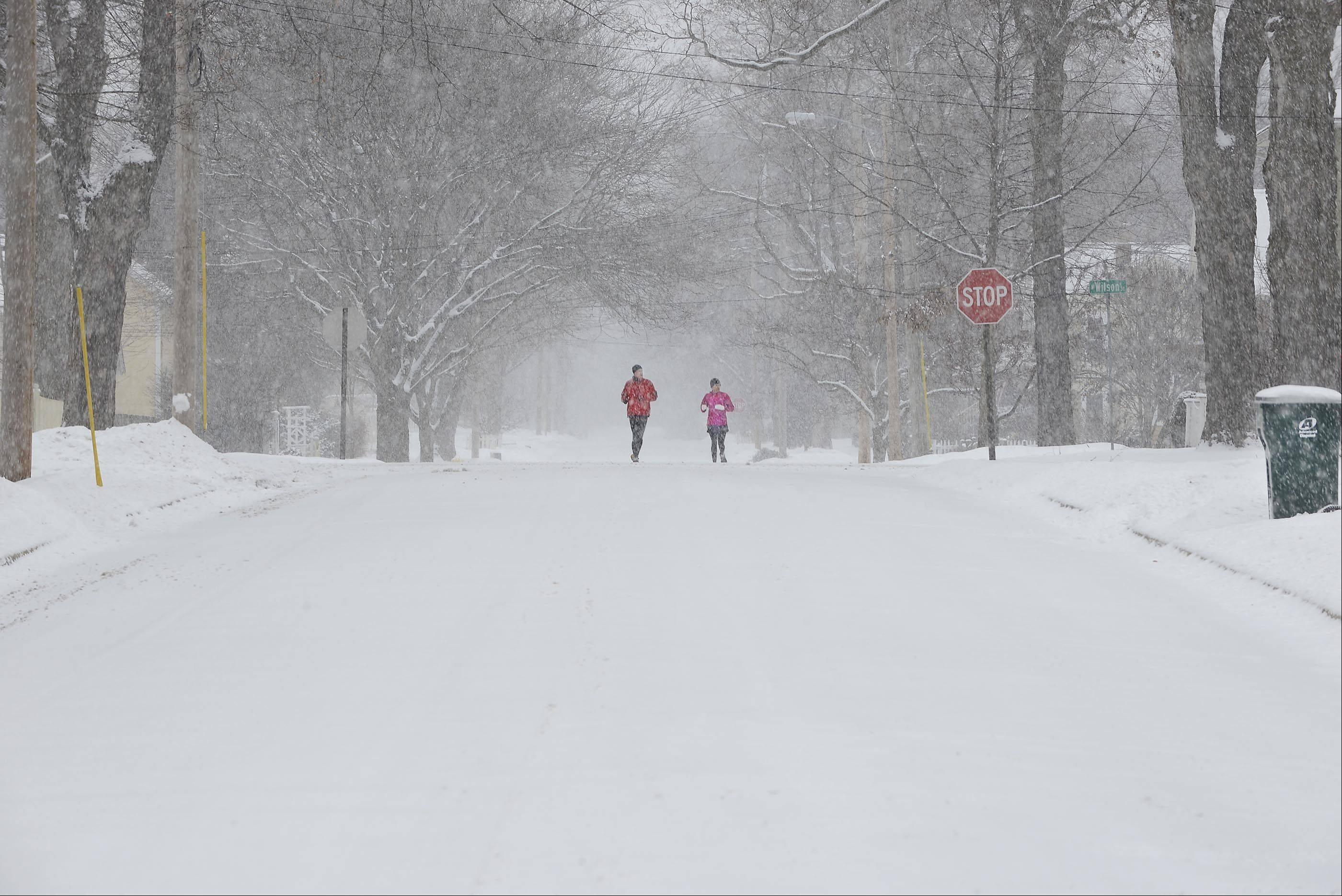 Brian and Gwen Joosse, of Batavia, run through their neighborhood on the west side of Batavia early on New Year's Day.