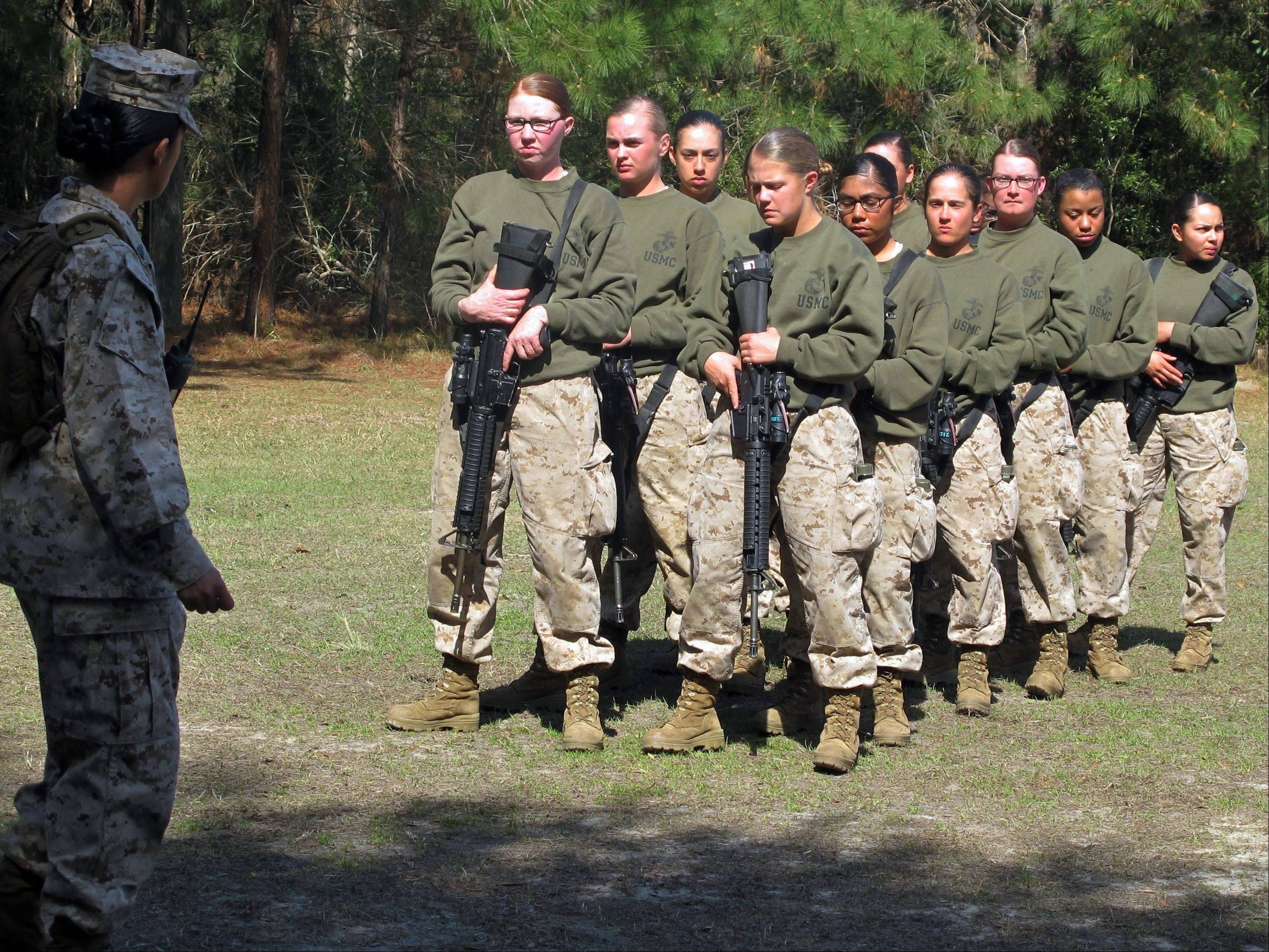ASSOCIATED PRESSFemale recruits are seen at the Marine Corps Training Depot on Parris Island, S.C. More than half of female Marines in boot camp can't do three pull-ups, the minimum standard that was supposed to take effect with the new year.