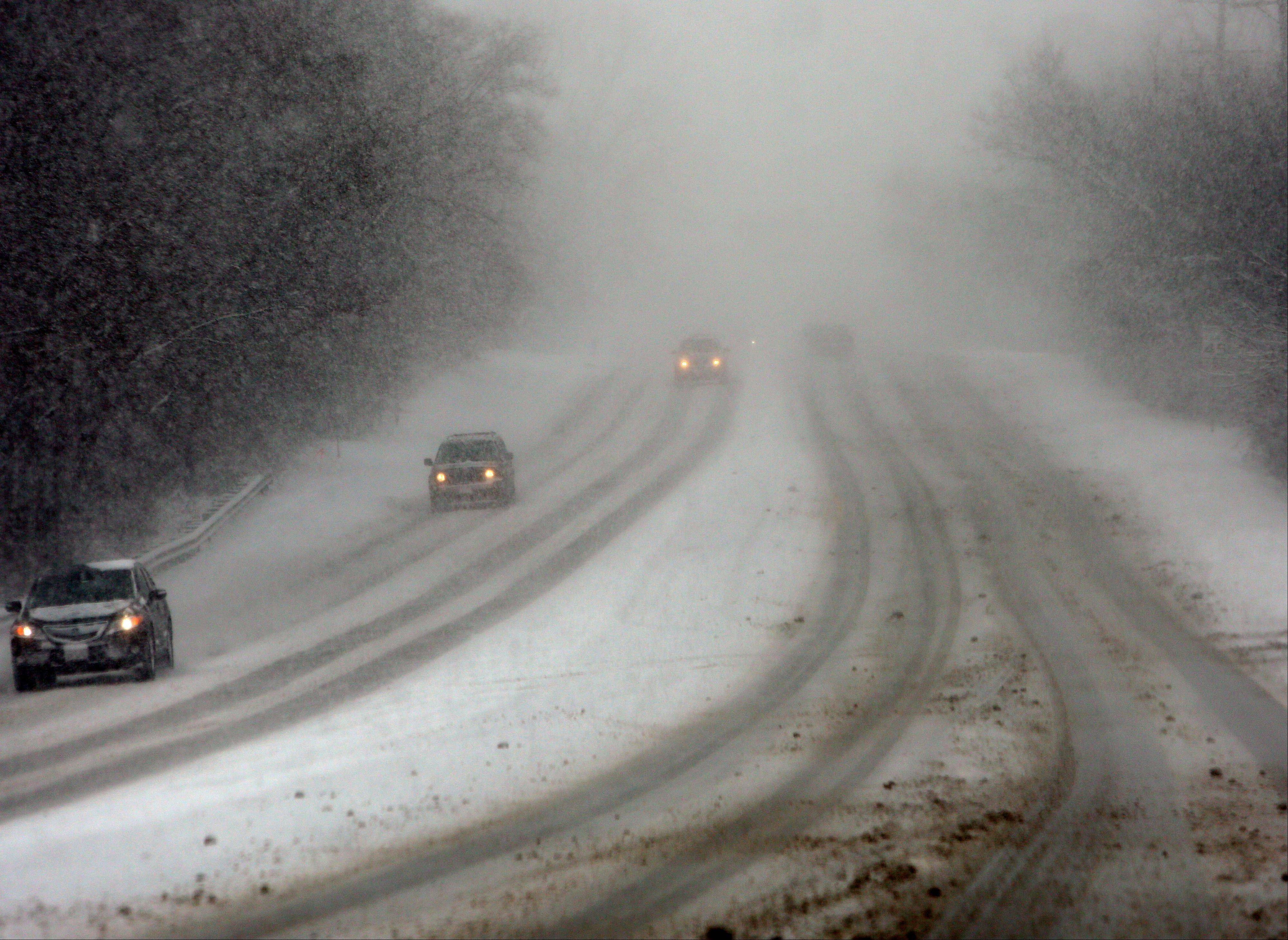 Road conditions were hazardous and visibility low along Warrenville Road in Lisle during lake effect snow on Thursday morning.