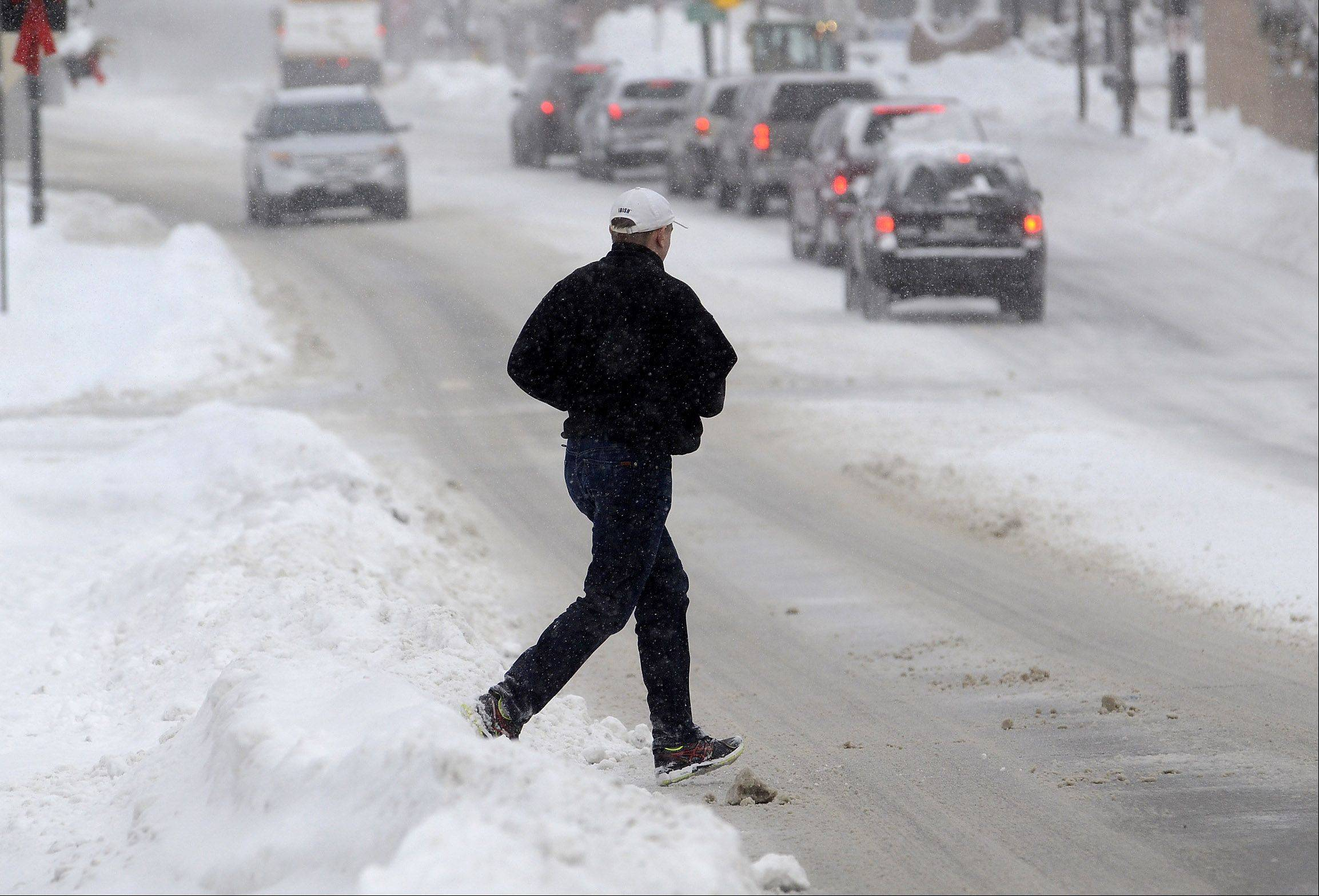 Pedestrians took to the streets in downtown Barrington Thursday morning, as sidewalks were still not totally cleared after 10 inches of snow fell since Wednesday.