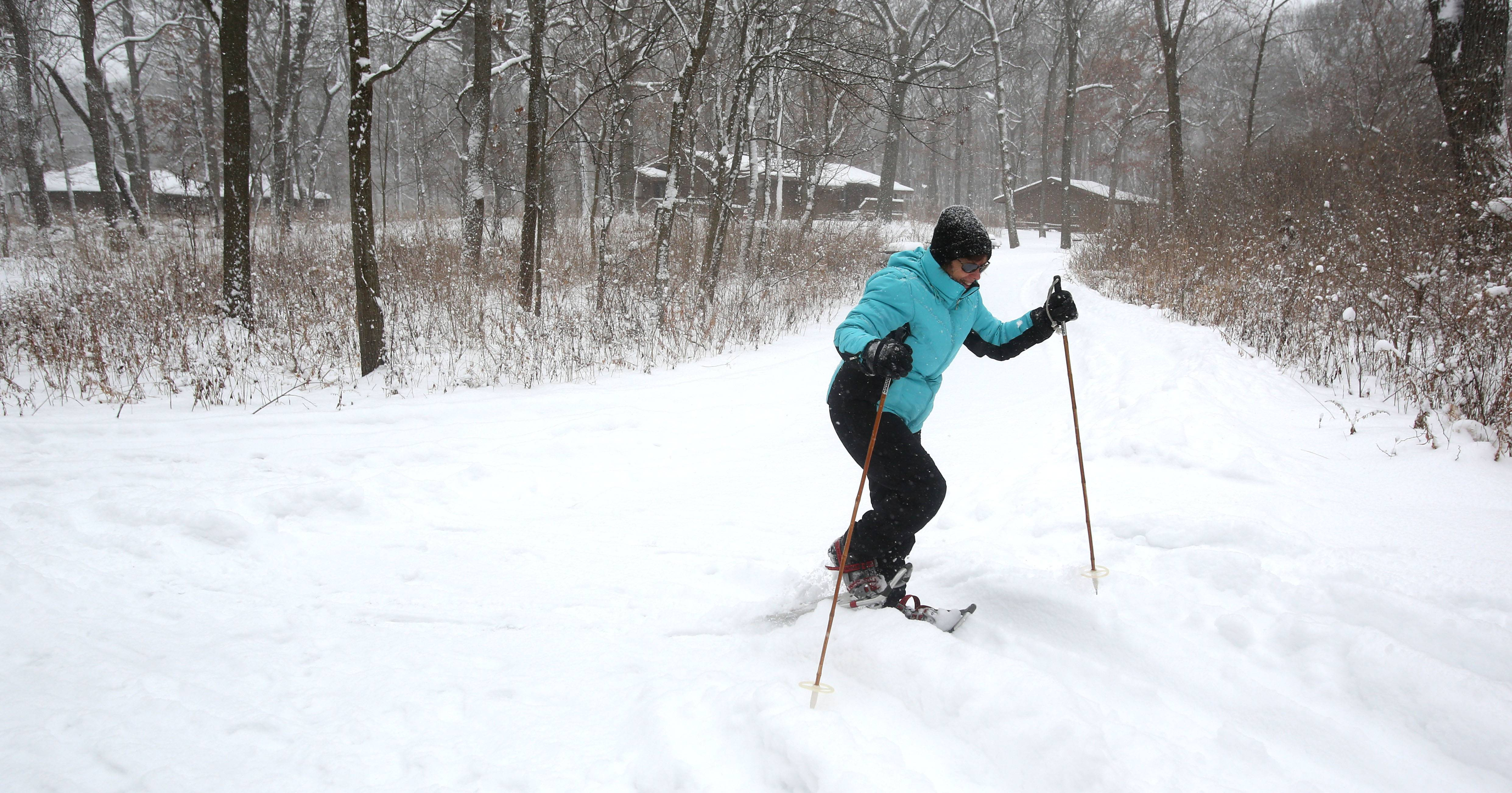 Harriet VerGowe of Western Springs enjoys snow shoeing at Fullersburg Woods in Oak Brook.