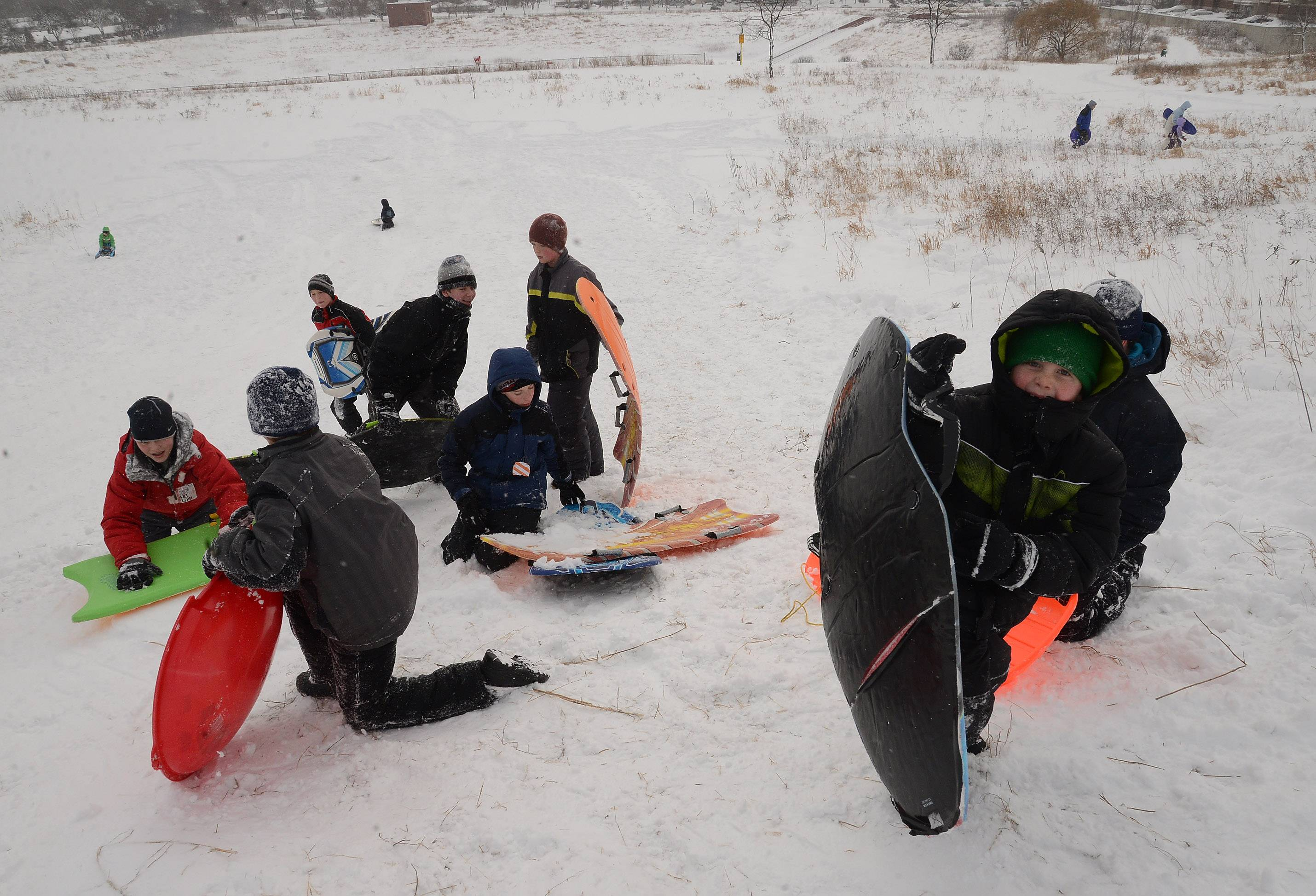 Sledders have a field day in the snow at Reimer Reservoir in Palatine.