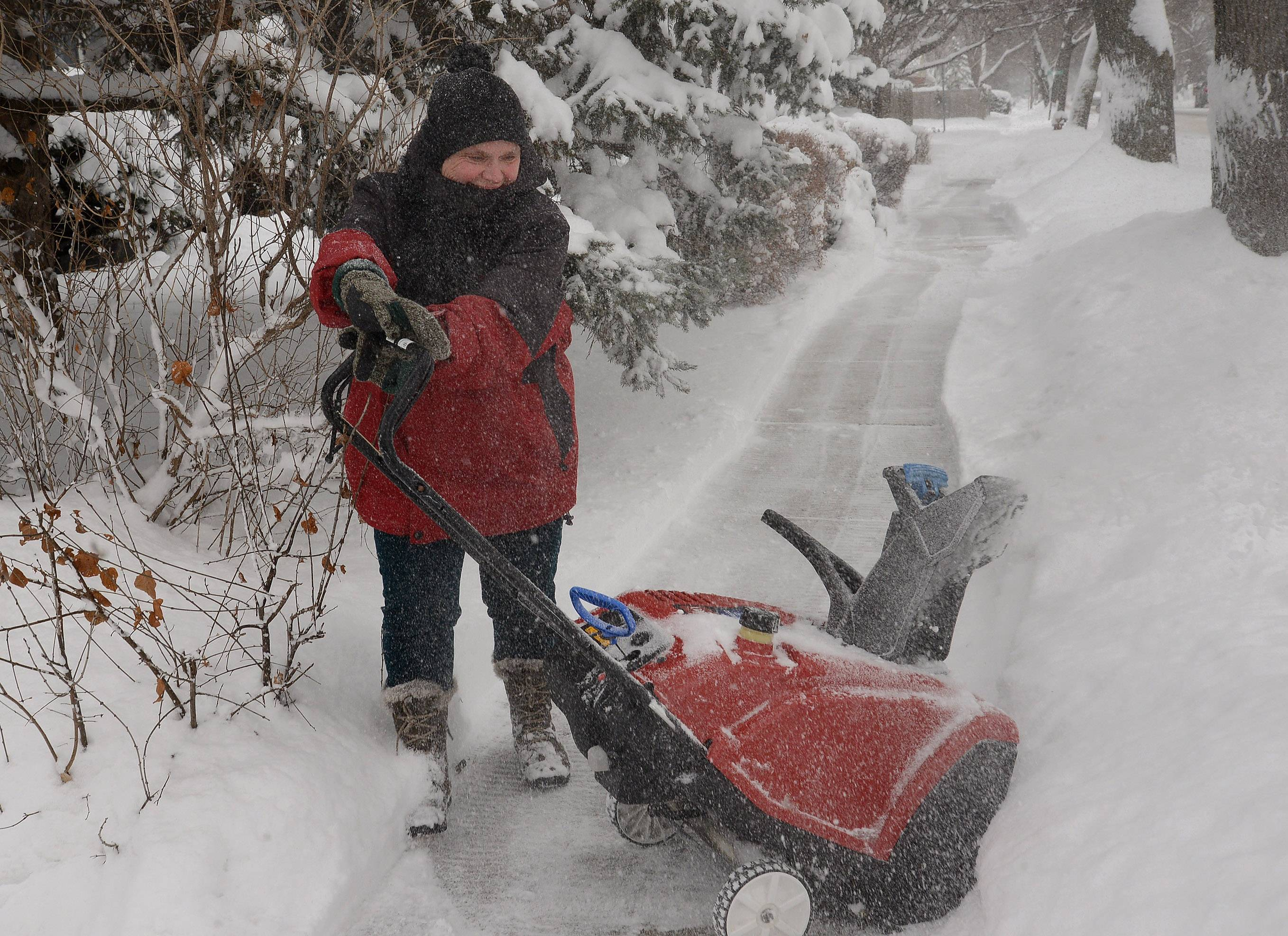 Mary Davis has used her snowblower 5 or 6 times in the last 24 hours on her sidewalk and driveway on Campbell  Street in Arlington Heights.