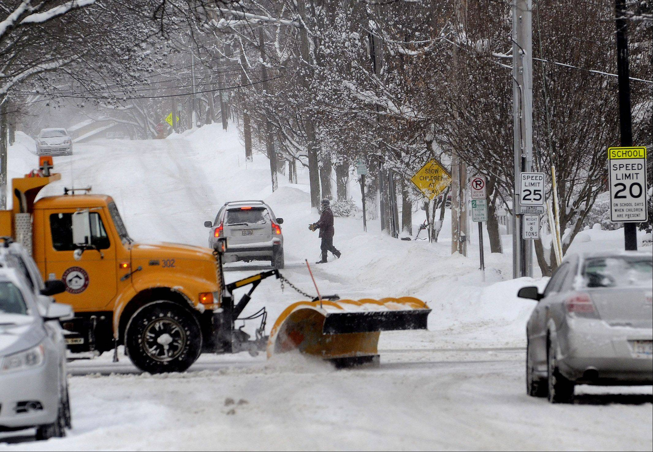 Plows continue to dig out downtown Barrington Thursday morning as 10 plus inches of snow fell overnight.