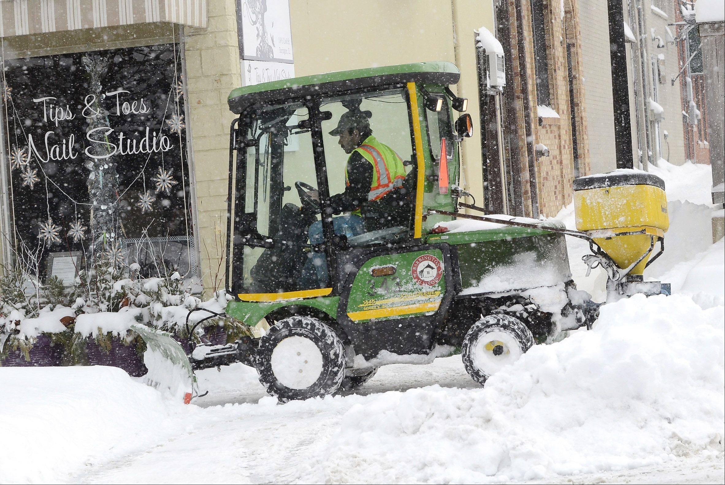 Connor Justes of Barrington Public Works says he's in the middle of a 12 hour shift that started last night at 1 a.m. plowing sidewalks and the train station in downtown Barrington.