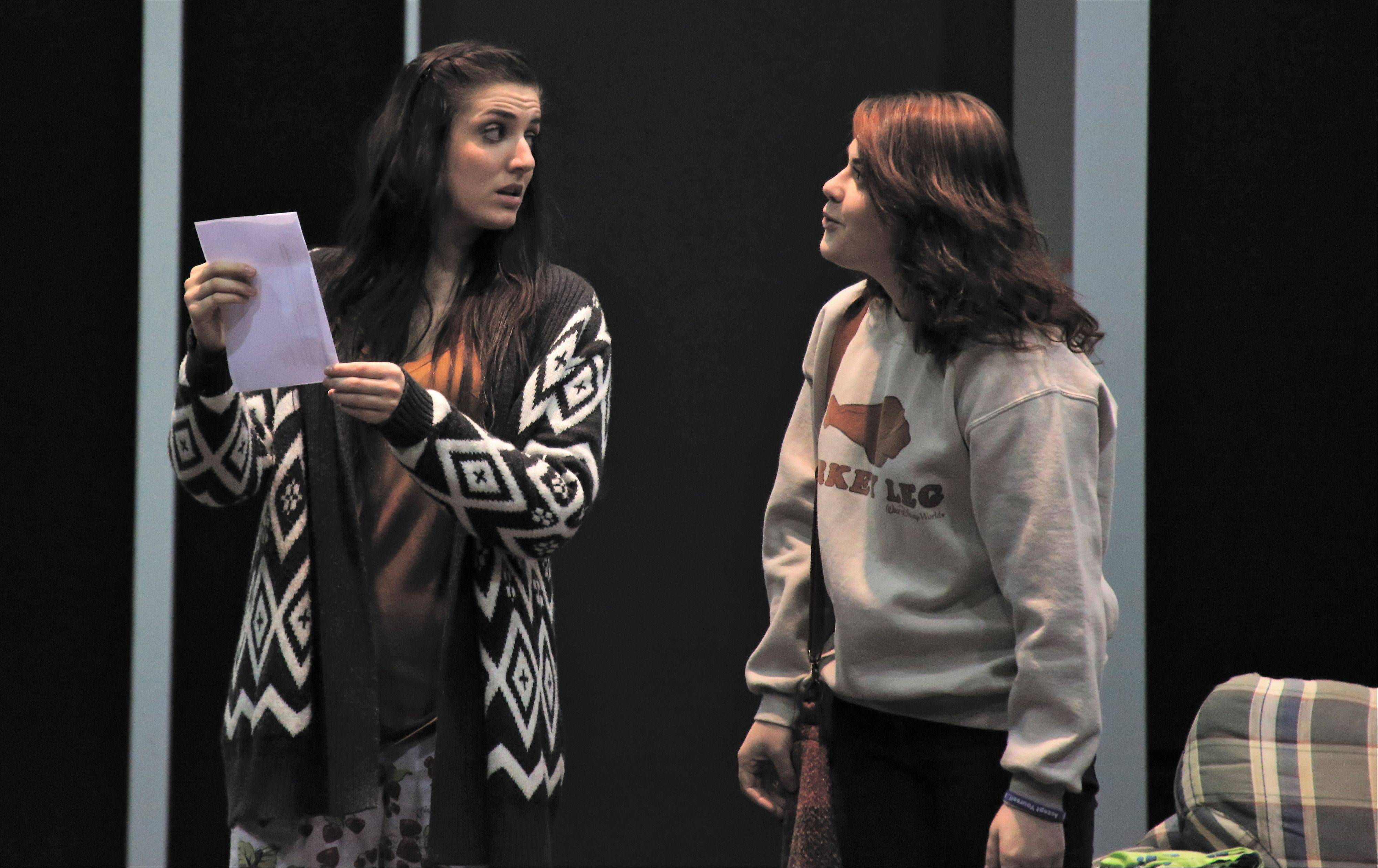 "Taylor Calderone, left, and Zoe Roechner rehearse a scene from the comedy ""Somebody/Nobody"" that opens Jan. 16 at Naperville's North Central College."