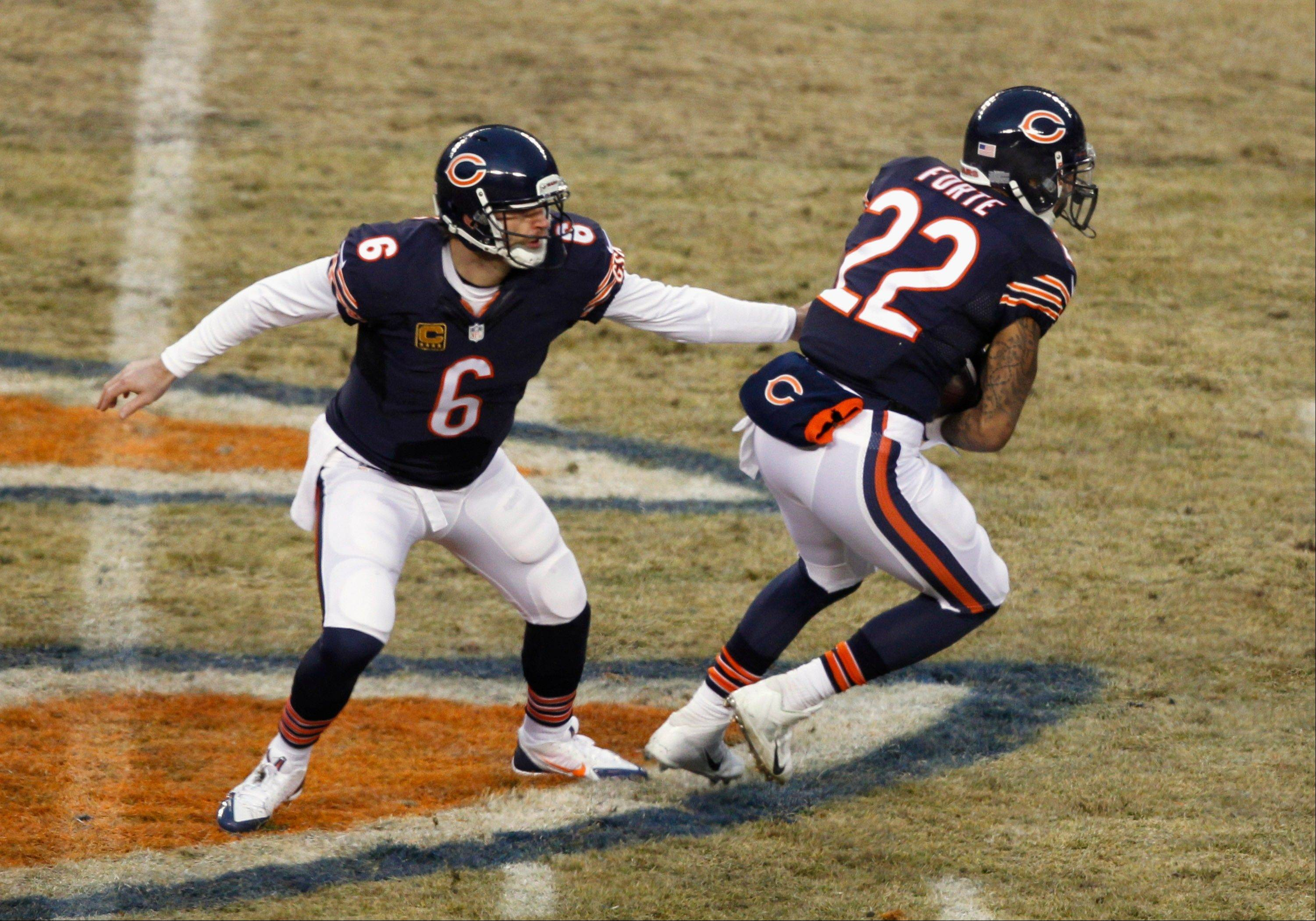 Bears quarterback Jay Cutler, handing off to running back Matt Forte during Sunday's season-ending loss to Green Bay, is a big piece of the team's championship goals.