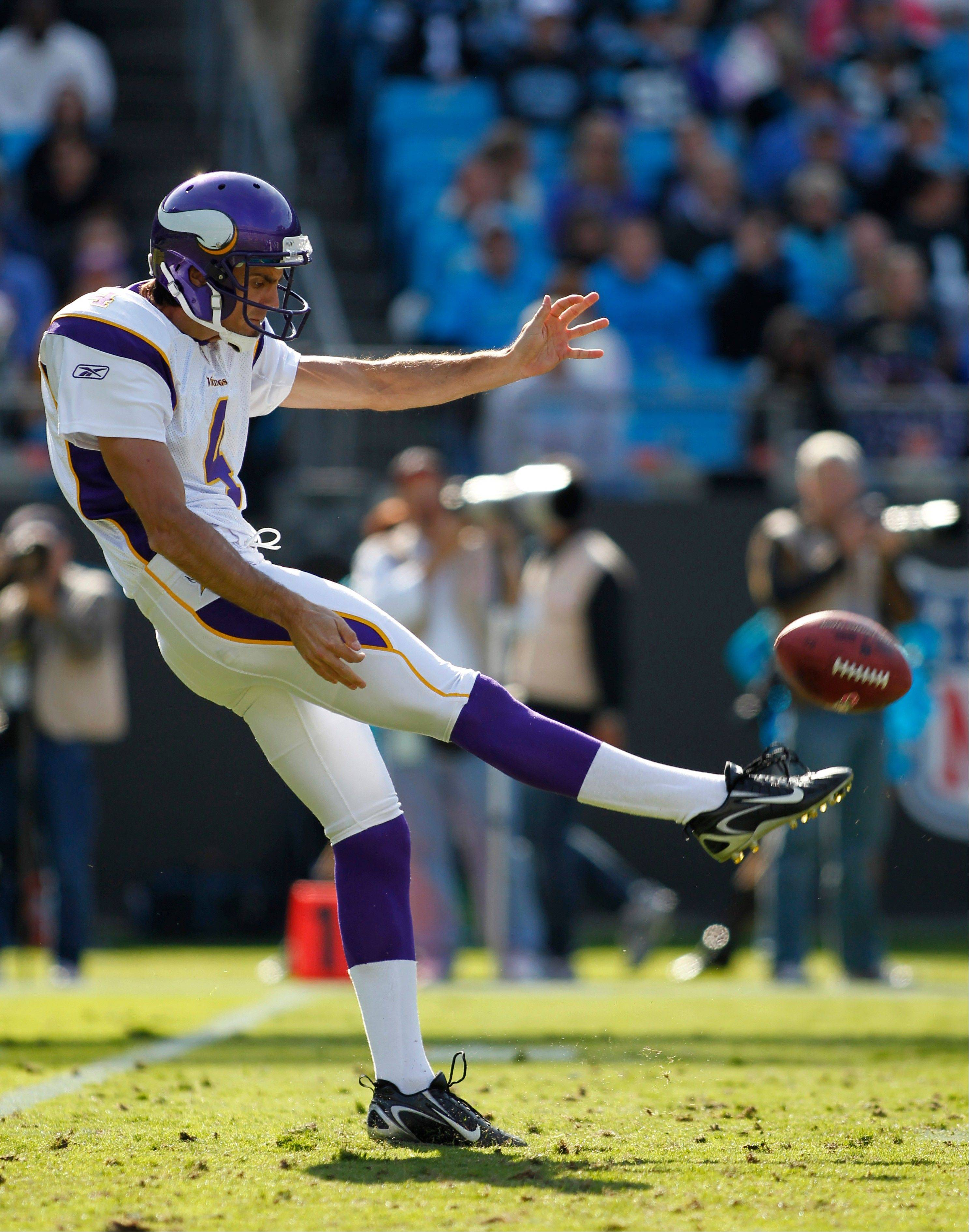 In this Oct. 30, 2011, photo, Minnesota Vikings' Chris Kluwe punts to the Carolina Panthers during an NFL football game in Charlotte, N.C. Kluwe, who is no longer with the Vikings, says the team's special teams coordinator, Mike Priefer, made anti-gay comments while Kluwe was with the team.
