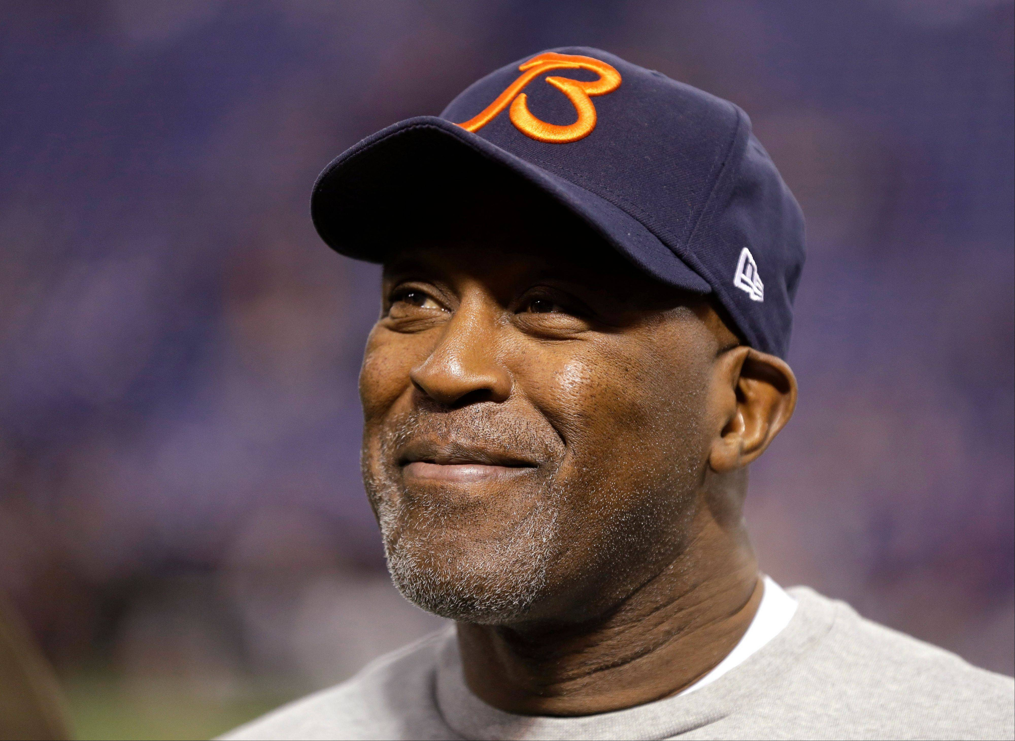 In this Dec. 9, 2012, photo, Chicago Bears coach Lovie Smith smiles before the Bears' NFL football game against the Minnesota Vikings in Minneapolis. A person familiar with the negotiations says former Bears coach Smith has reached an agreement to coach the Tampa Bay Buccaneers. Speaking to The Associated Press on Wednesday night, Jan. 1, 2014, on the condition of anonymity because an official announcement hasn't been made, the person also says former Minnesota Vikings coach Leslie Frazier will be the Buccaneers' defensive coordinator.
