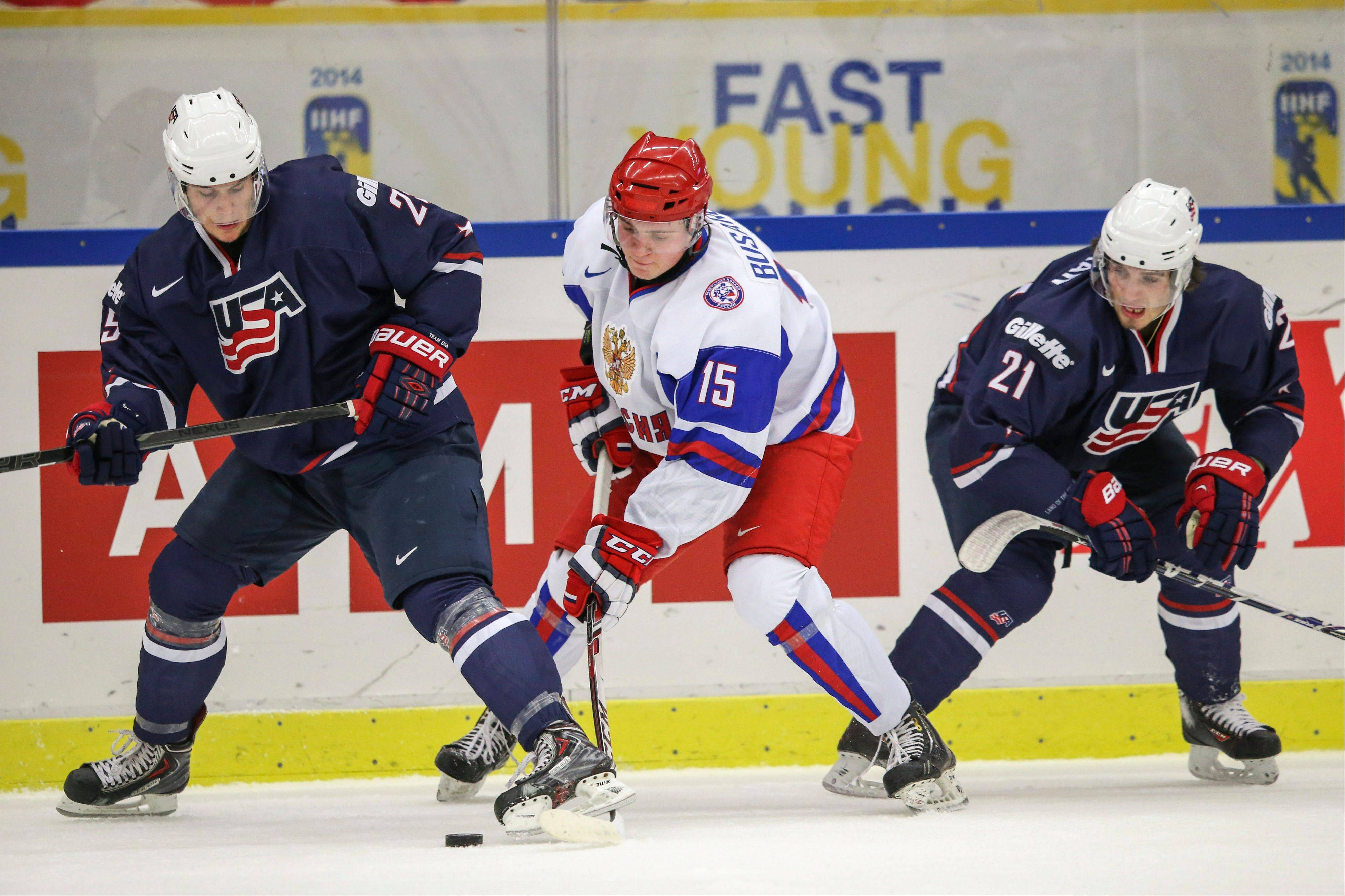 Russia's Georgi Busarov, center, vies with Quentin Shore, left, and Ryan Hartman, right, of the USA during their World Junior Hockey Championships quarter final in Malmo, Sweden on Thursday. West Dundee and Blackhawks prospect Hartman scored, but the U.S. still fell to Russia 5-3.