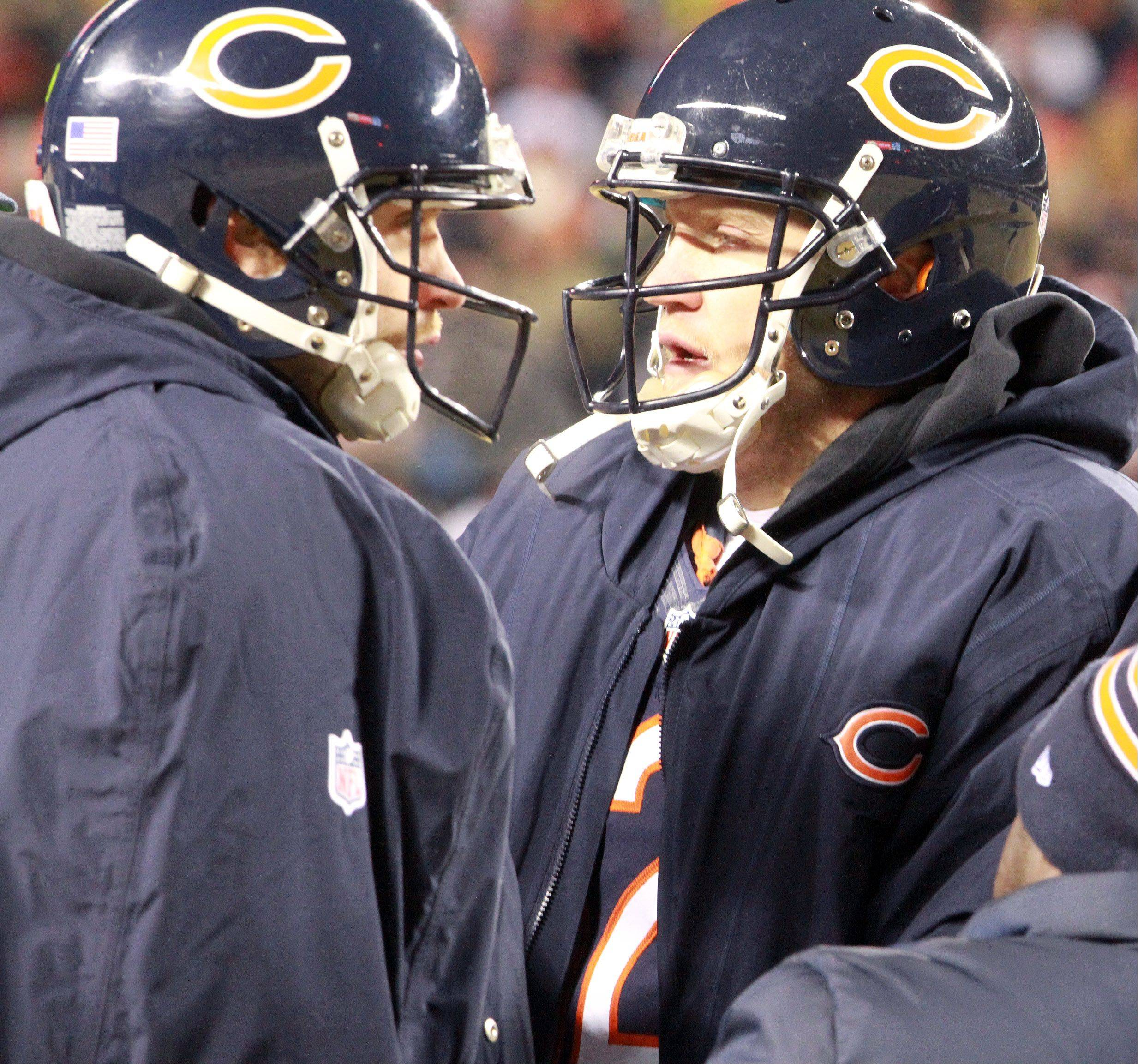 Chicago Bears quarterback Jay Cutler, left, has signed a 7-year deal to stay with the Bears, GM Phil Emery announced Thursday. Backup QB Josh McCown, right, is free agent.