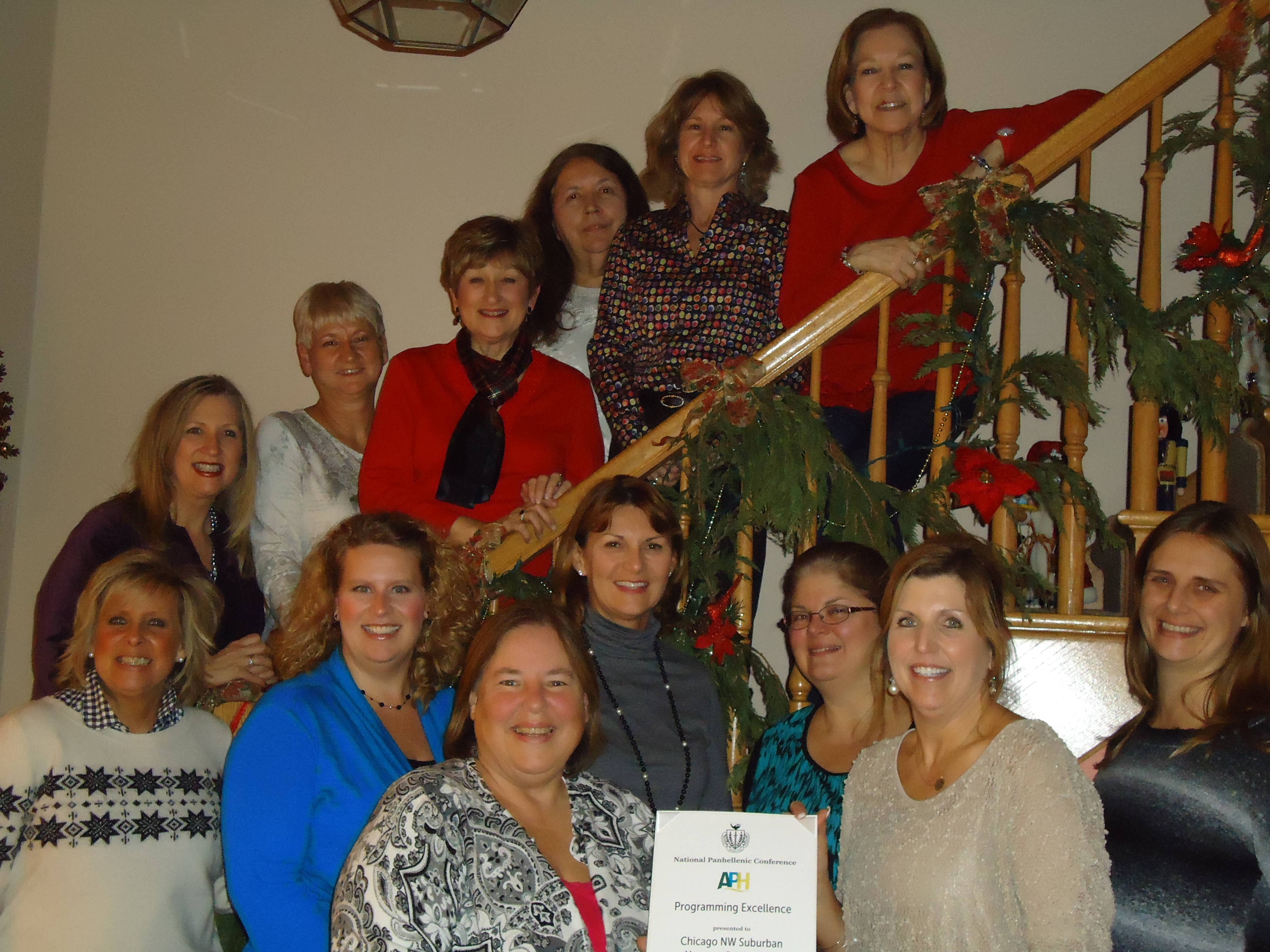 Taken at the presentation of the NPC Programming Excellence Award given to the Chicago Northwest Suburban Alumnae Panhellenic.  In the front to the left is Barb Bay, President of Chicago Northwest Suburban Panhellenic, and to the right is Kathi Heatherly of the National Panhellenic Conference.  Others in the picture are representatives of the local affiliated sororities.