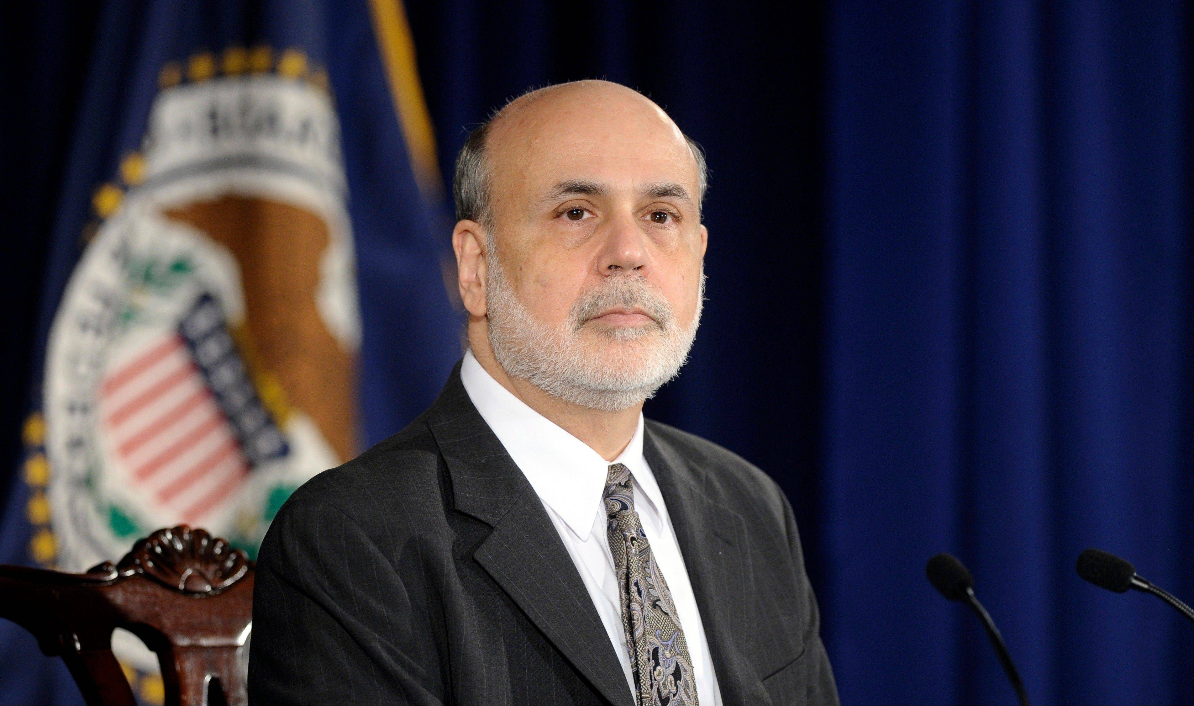 Federal Reserve Chairman Ben Bernanke listens to a question during a news conference at the Federal Reserve in Washington.
