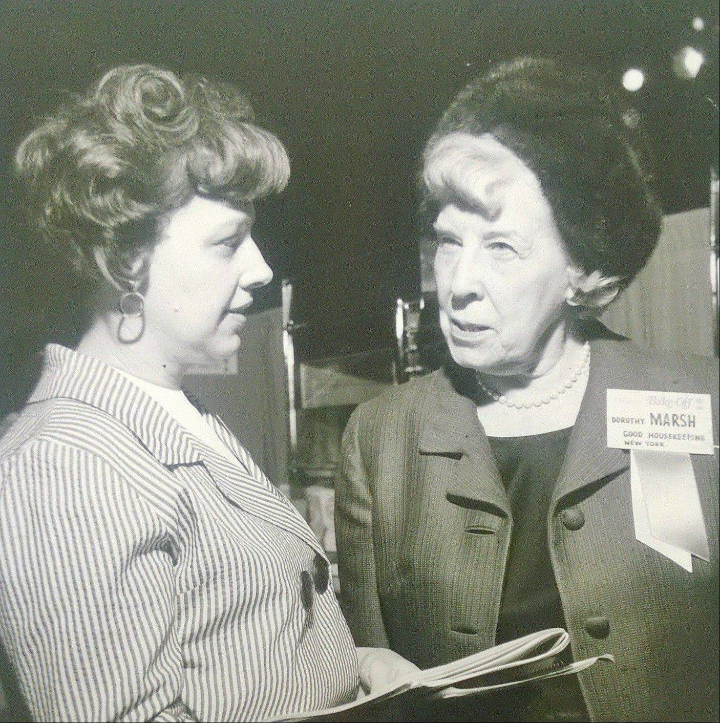 Suburban Living editor Pat Adam talks to Dorothy Marsh of Good Housekeeping magazine while covering the Pillsbury Bake-Off in 1967.