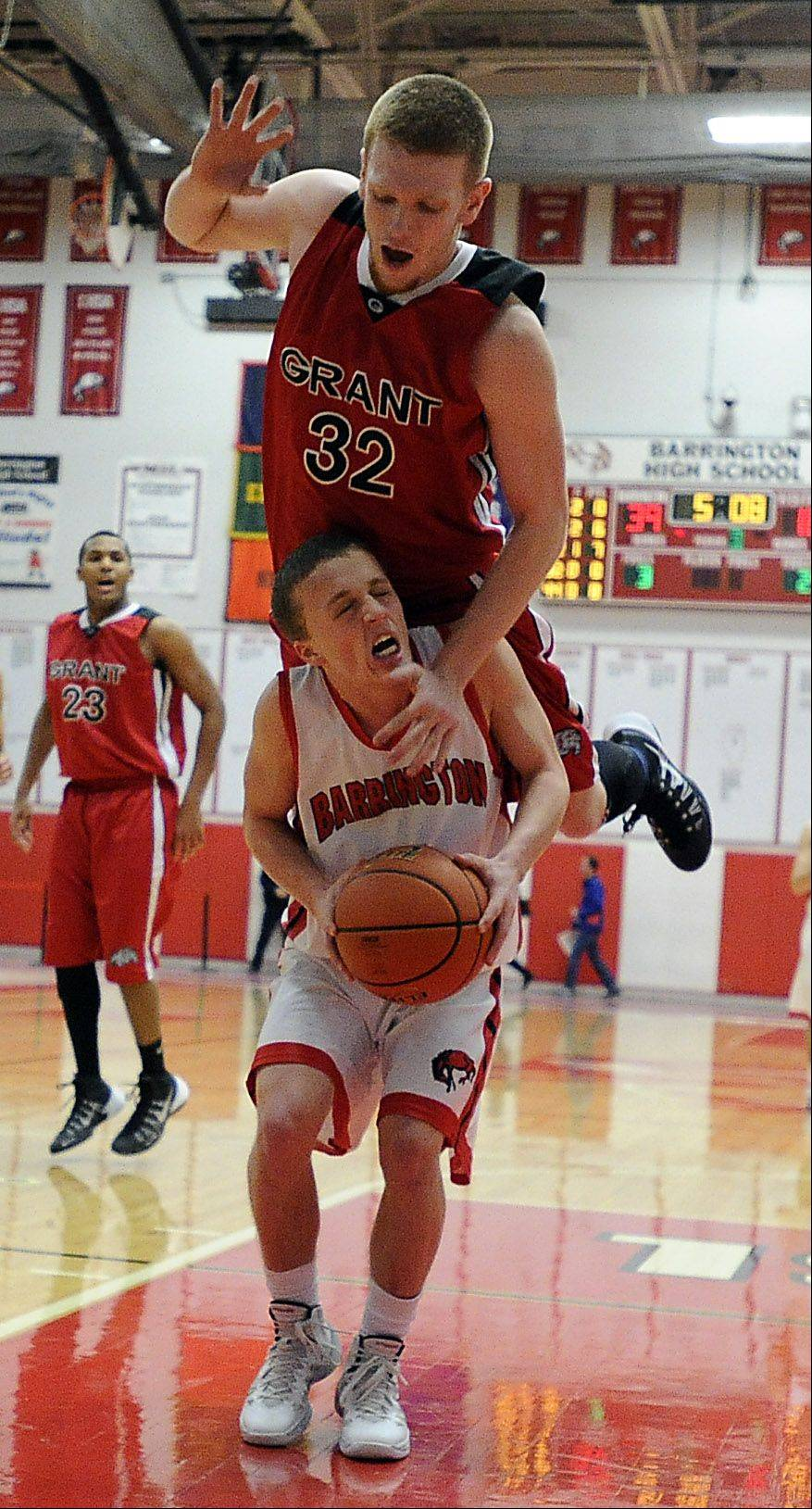 Grant�s Devin Bald goes up and over Barrington�s Jake Orr on Friday at Barrington.